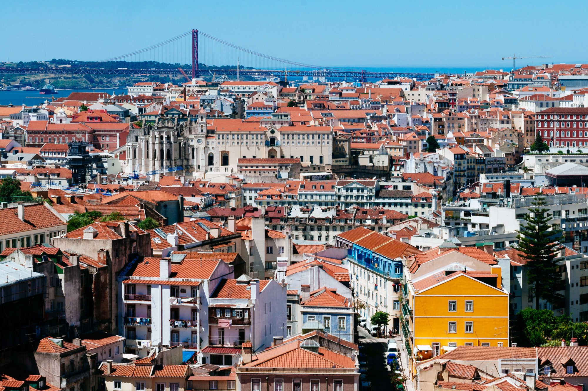 Lisbon cityscape with April 25th bridge at back