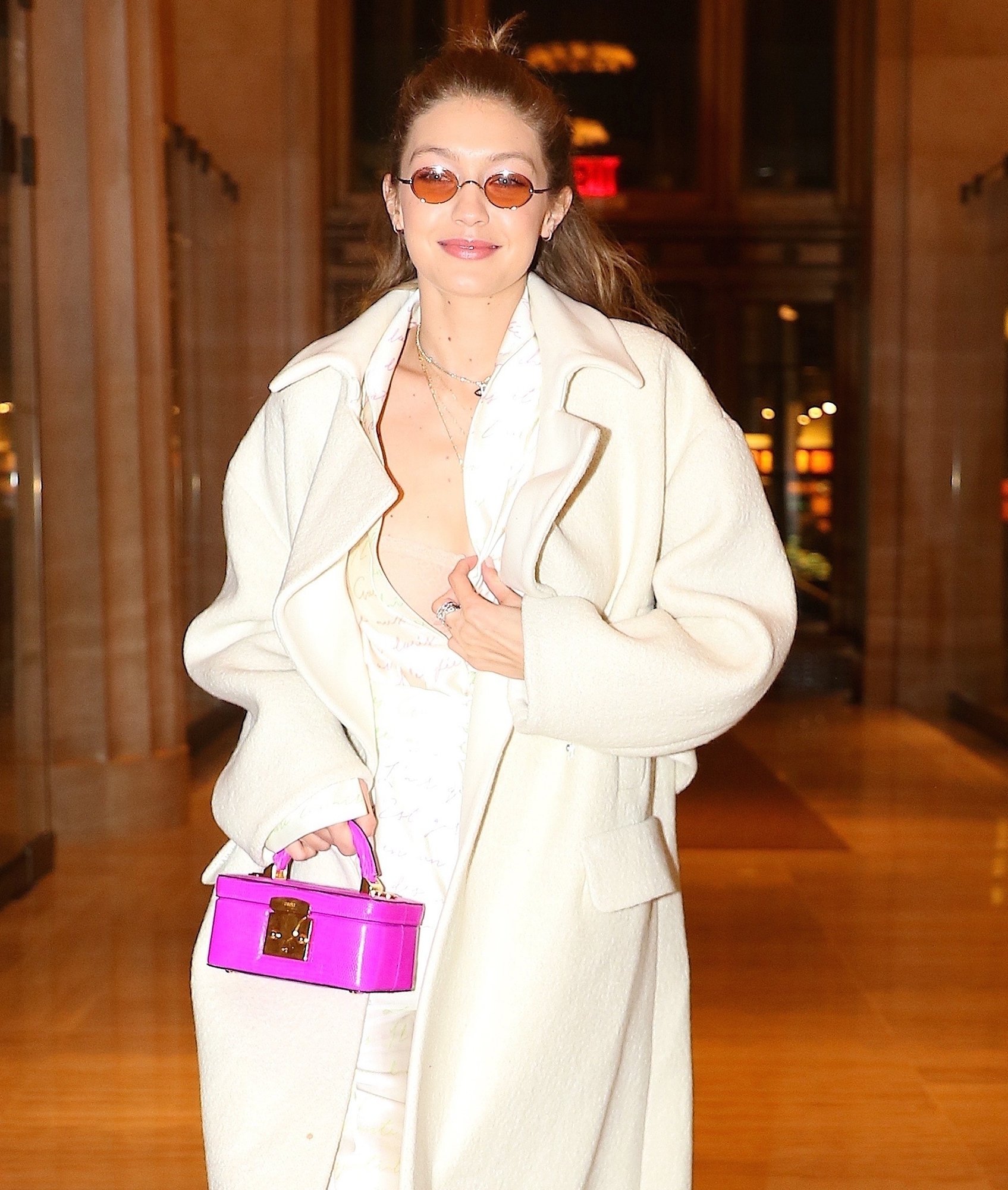 *EXCLUSIVE* Gigi Hadid adds a pop of color to her all white ensemble during a dinner outing in NYC