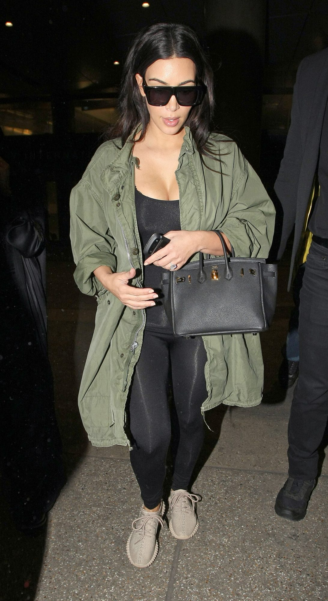 Kim and Kourtney Kardashian arrive at LAX airport in Los Angeles, CA