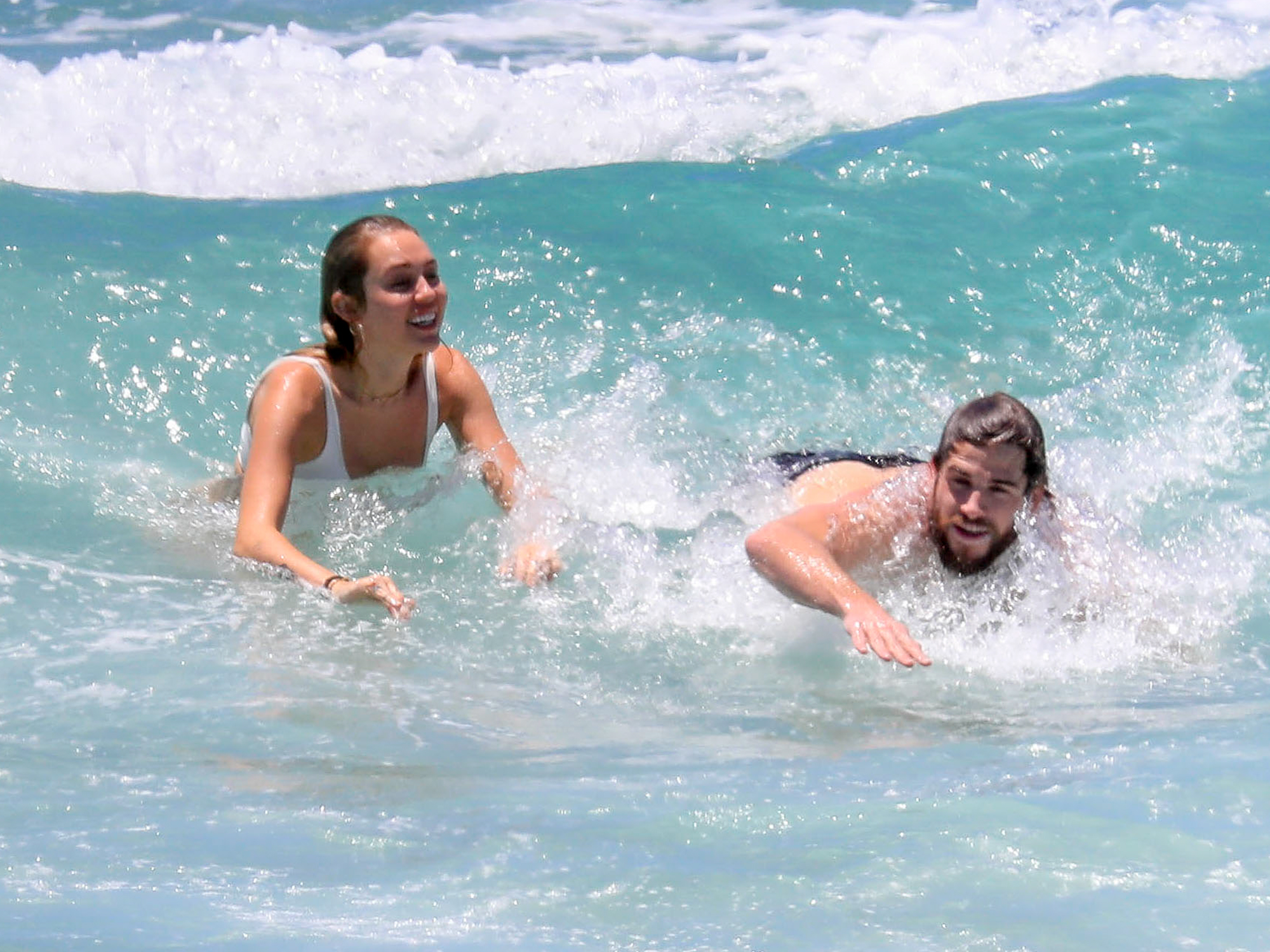 EXCLUSIVE: **NO US PRINT** **PREMIUM EXCLUSIVE RATES APPLY* Miley Cyrus and Liam Hemsworth enjoy a day at the beach on their Australian summer vacation in Byron Bay.