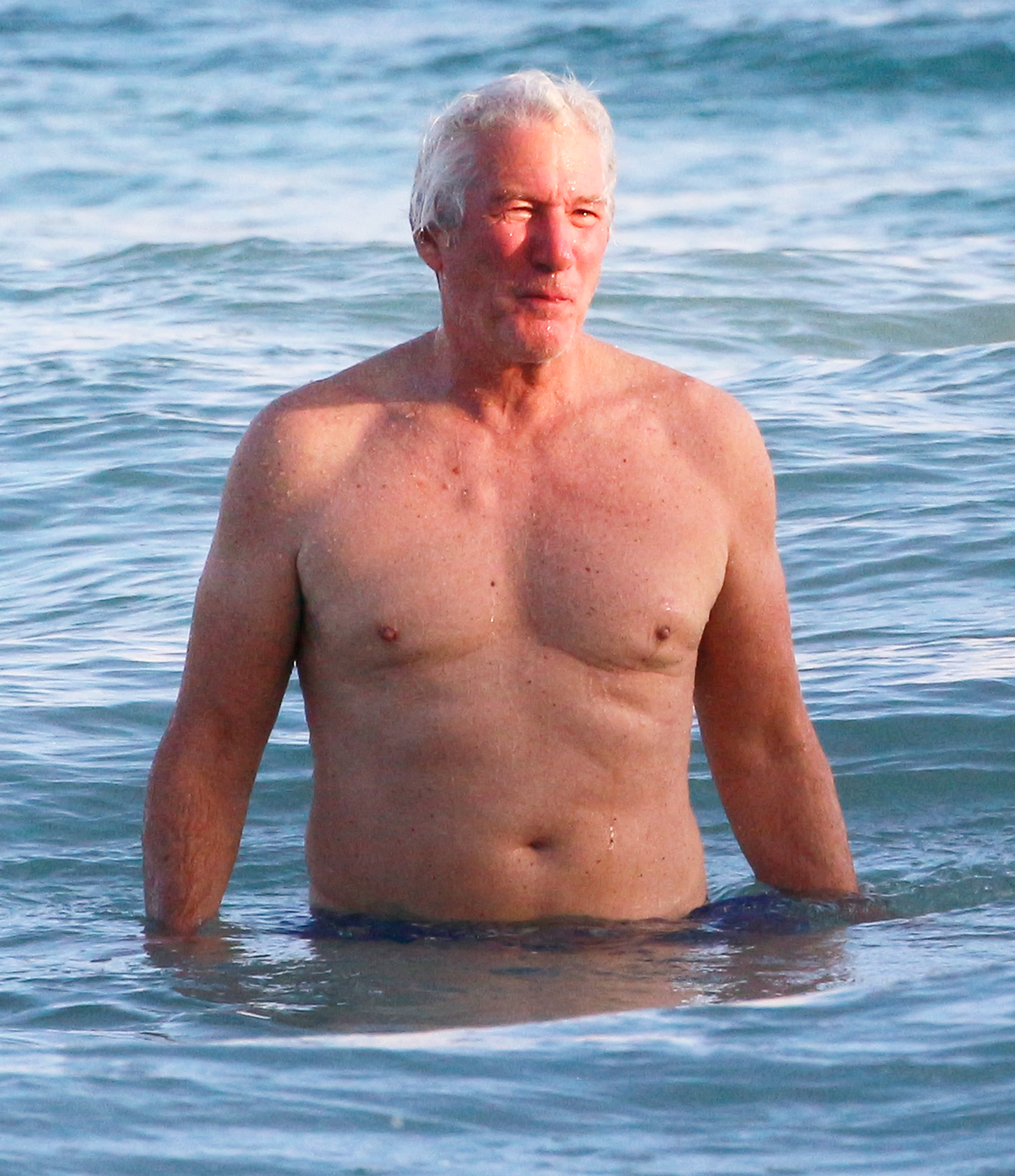 EXCLUSIVE: Richard Gere takes a dip in the ocean during his festive Mexican vacation