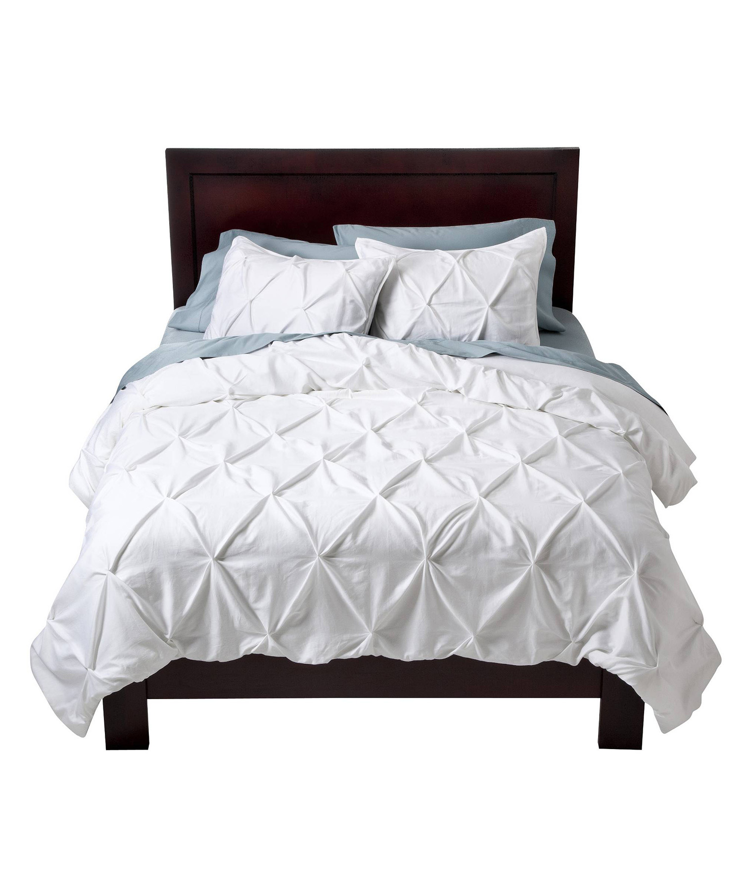 Pleated White Comforter on bed