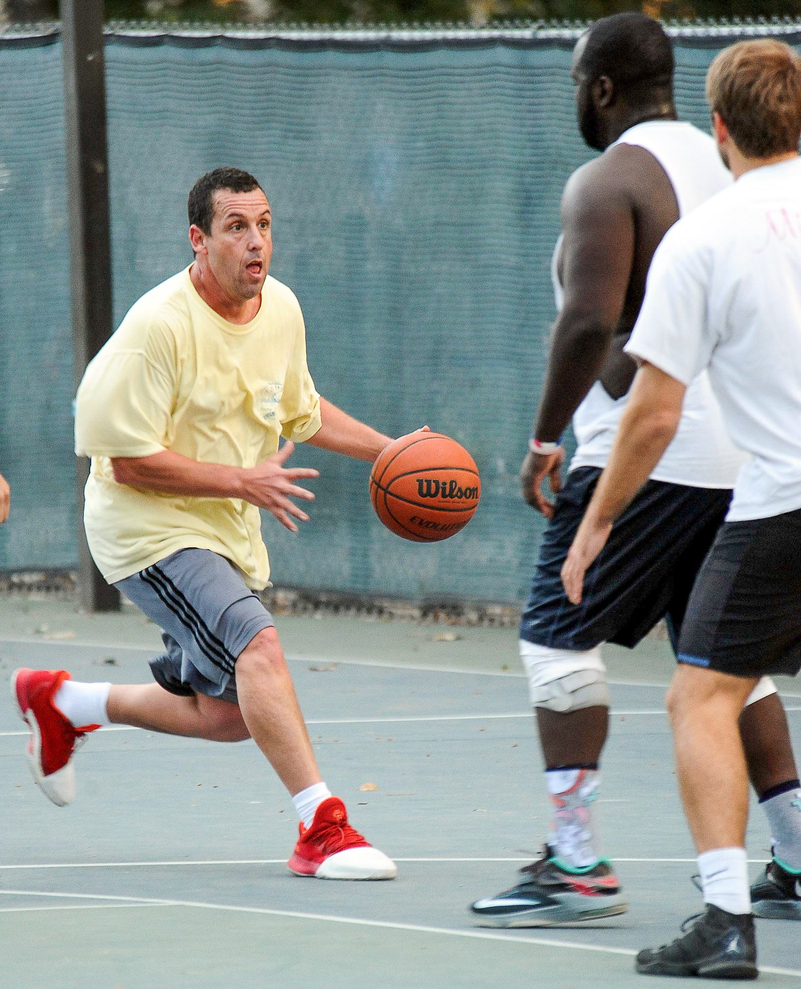 EXCLUSIVE: Comedian Adam Sandler shows off some pretty fancy ball handling skills for a 51 year old as he plays a pickup game of Basketball in a park in Santa Monica, Ca