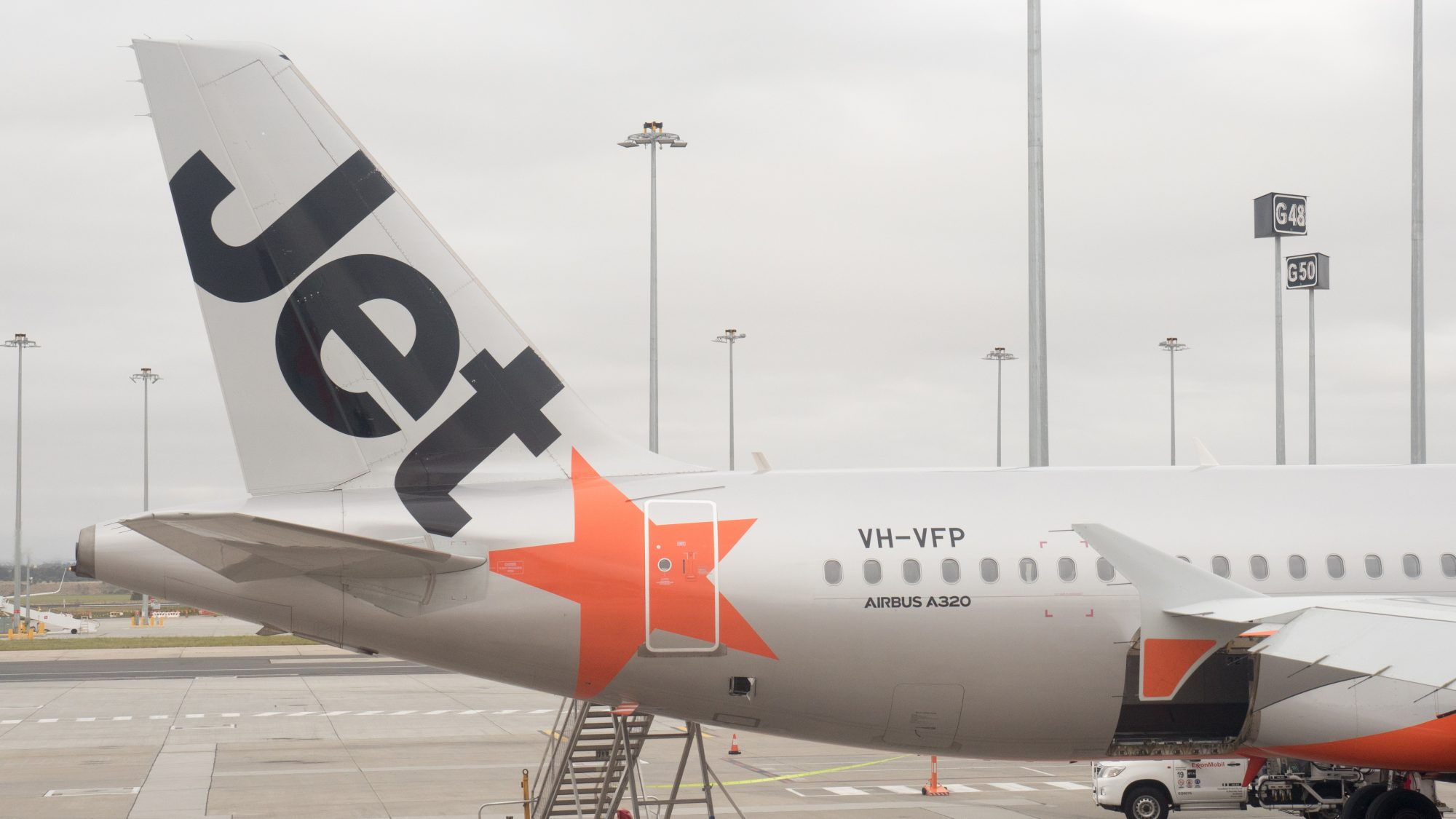Jetstar commercial airline at the gate at Melbourne Airport 4k