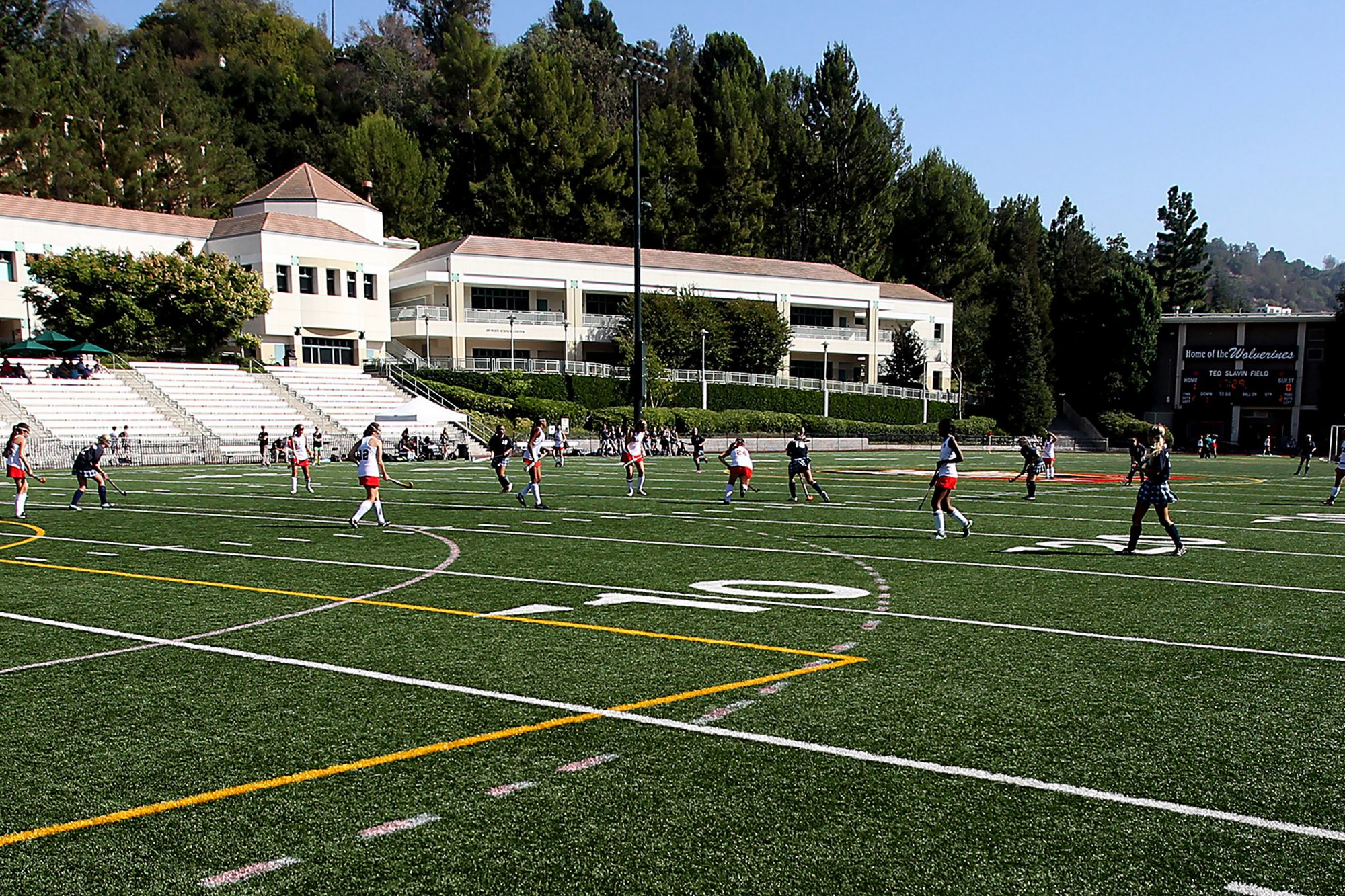 Girls play a game of field hockey on the athletic fields of  Harvard-Westlake School, an independen