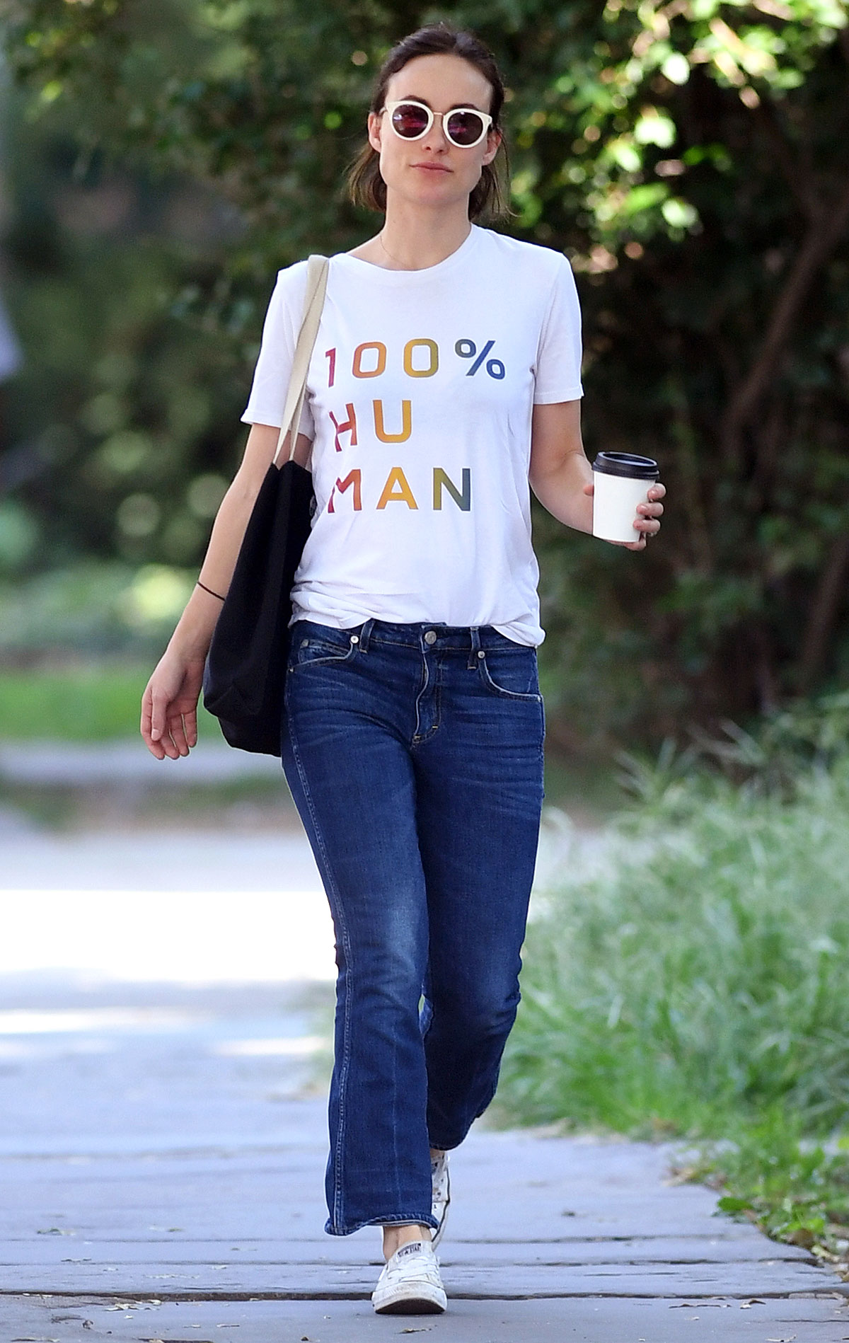 """EXCLUSIVE: Olivia Wilde wears """" Im 100% Human"""" T-shirt while getting her Coffe and heading to the Train Station this morning"""