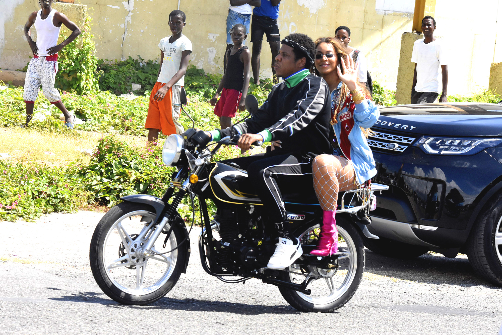 EXCLUSIVE: **PREMIUM EXCLUSIVE RATES APPLY**Jay-Z and Beyonce spotted shooting a video in Bob Marley's old stomping ground in Kingston.