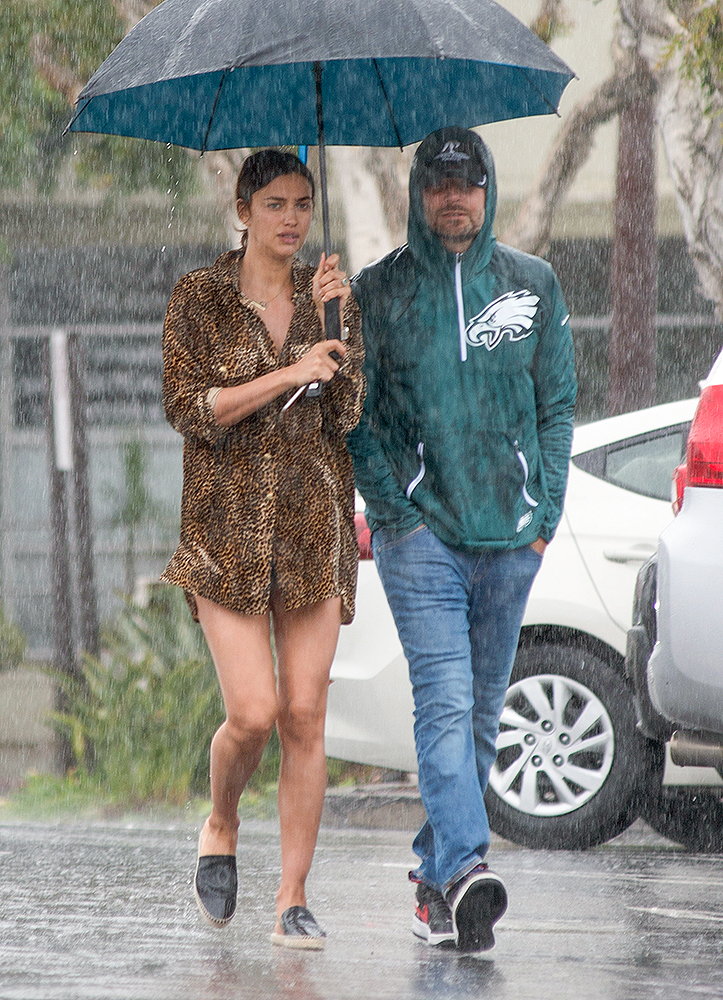 EXCLUSIVE: Bradley Cooper and Irina Shayk go Shopping in the Pouring Rain in Los Angeles