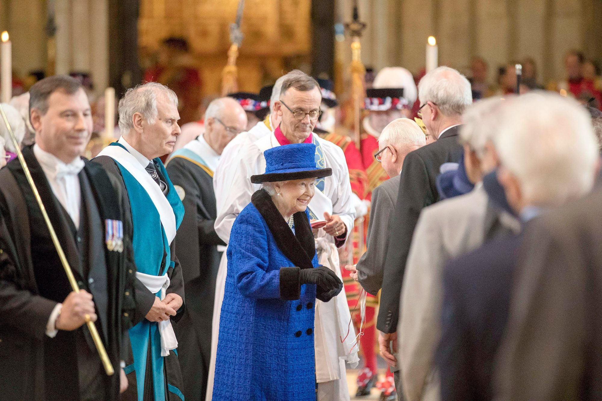 Queen Elizabeth Attends Royal Maundy Service at St George`s Chapel