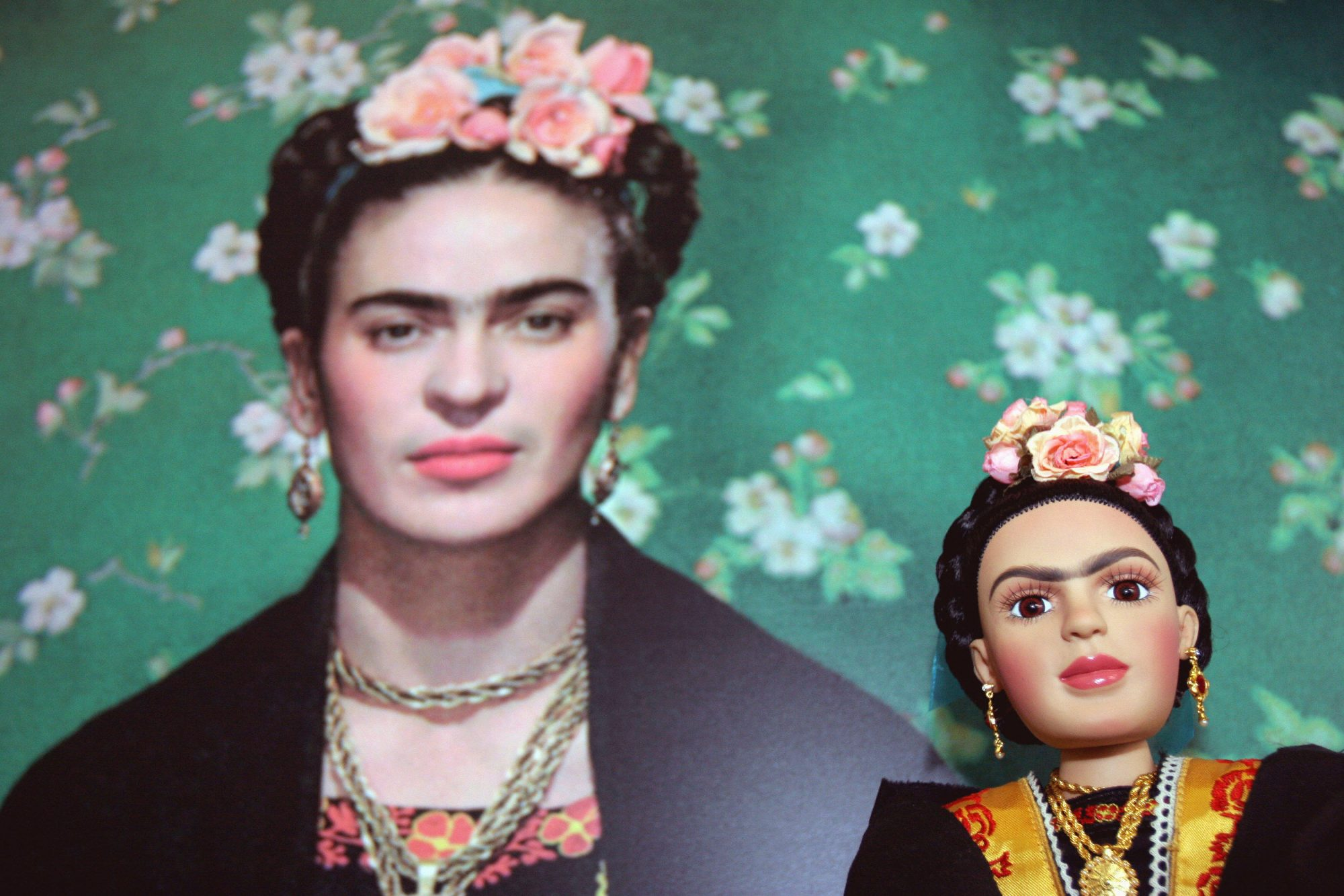 A Frida Kahlo doll is seen next to a pic