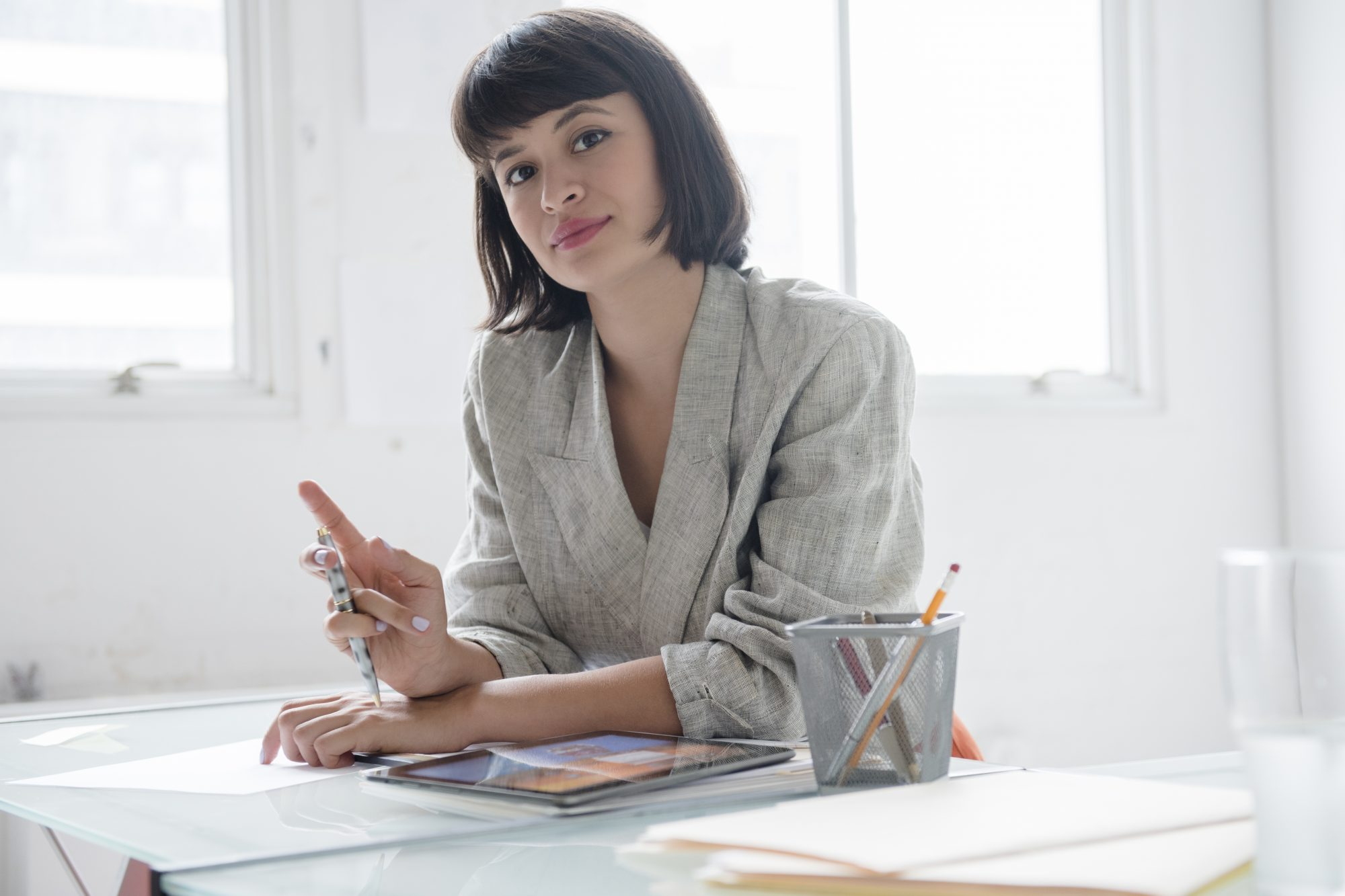 Hispanic businesswoman in office with digital tablet