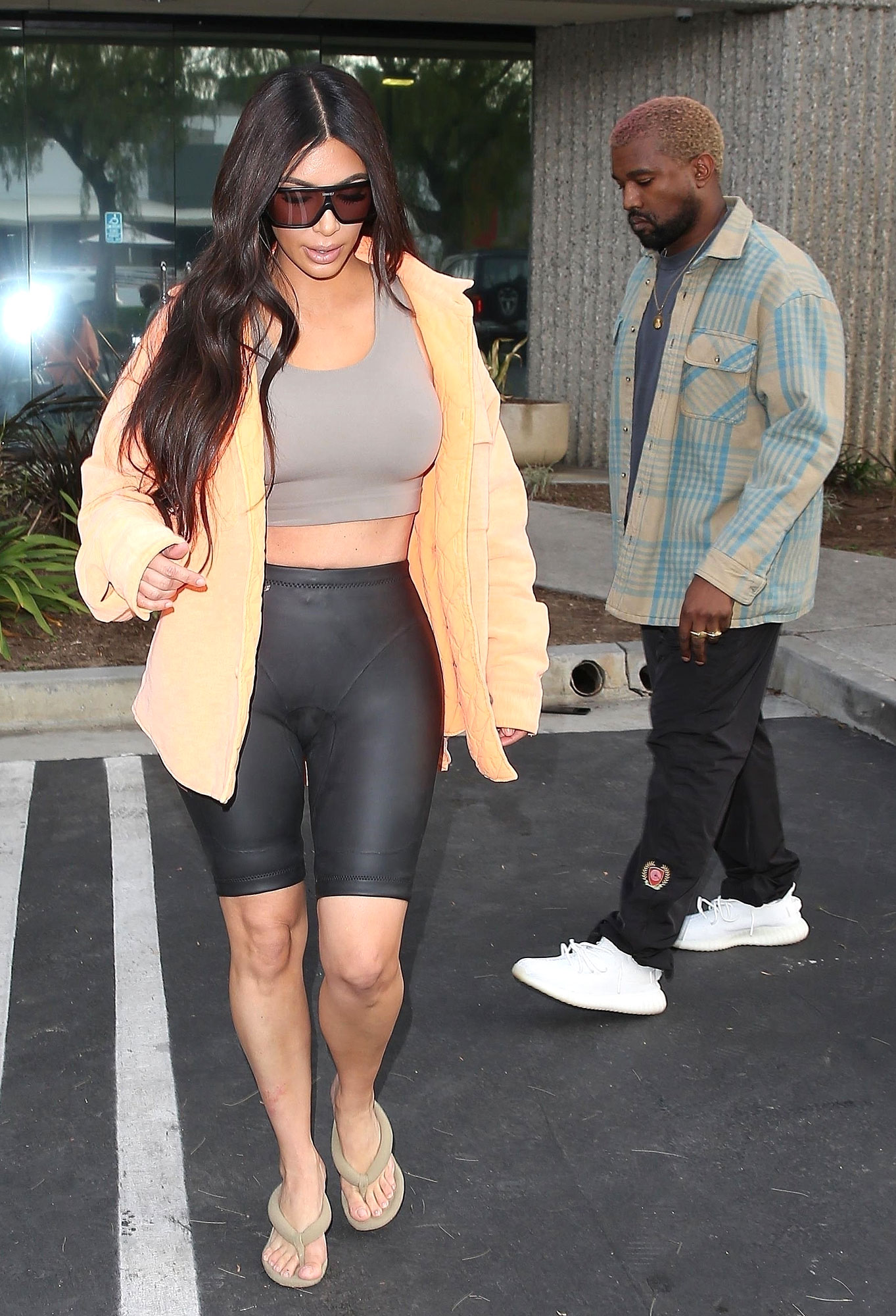 *EXCLUSIVE* Kim Kardashian wears biker shorts and bra top for mid-day visit to Kanye at the Studio