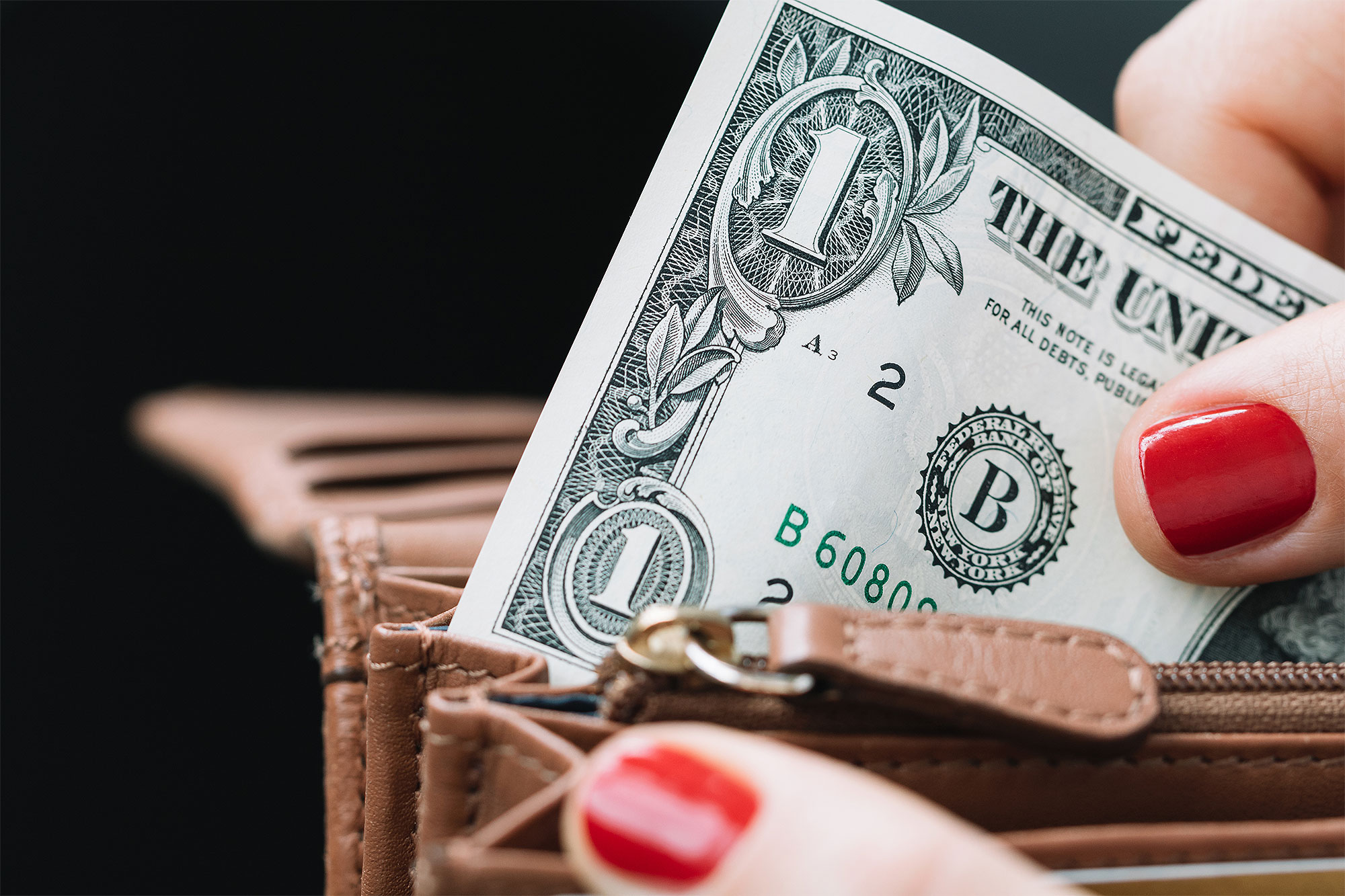 Close-Up Of One Dollar Bill In Wallet