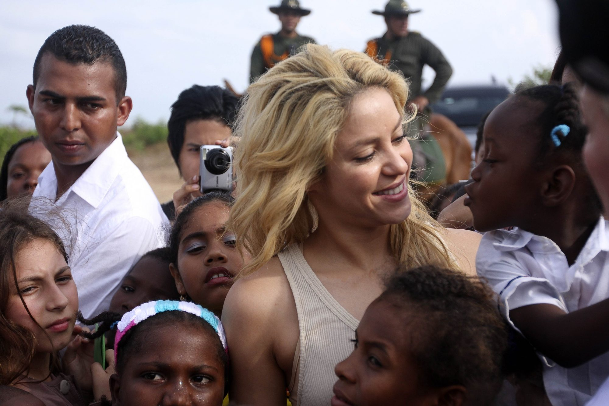 Colombian pop star Shakira greets a girl