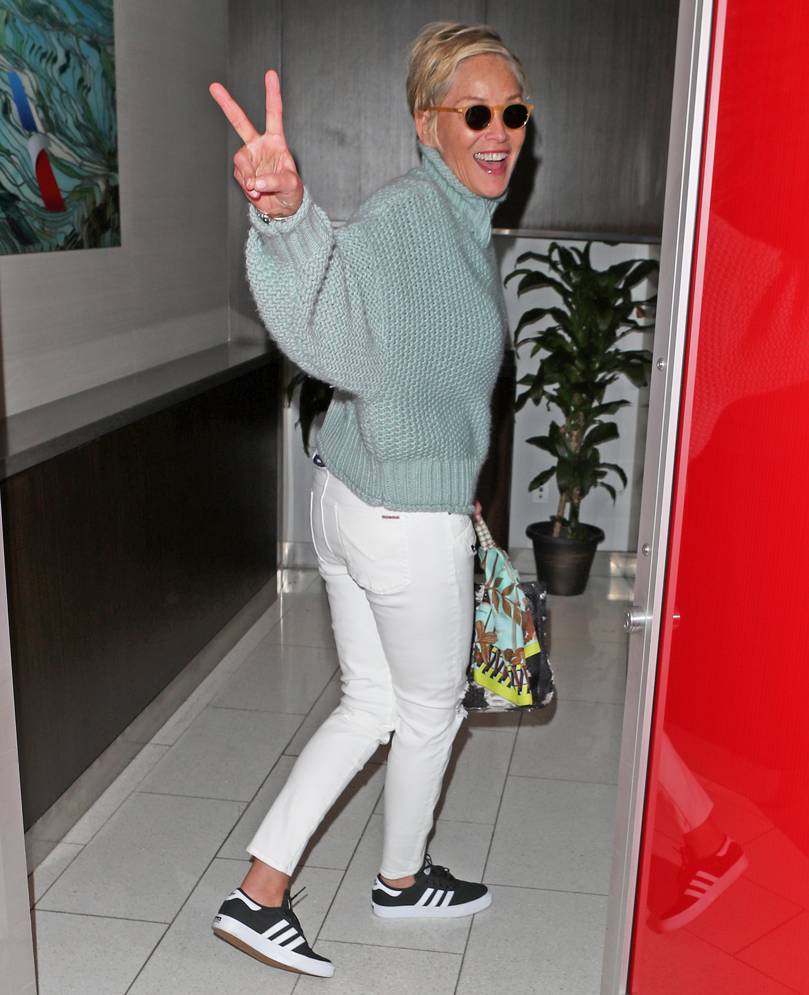 Sharon Stone happily signs her risquÈ Basic Instinct poster for fans at LAX airport