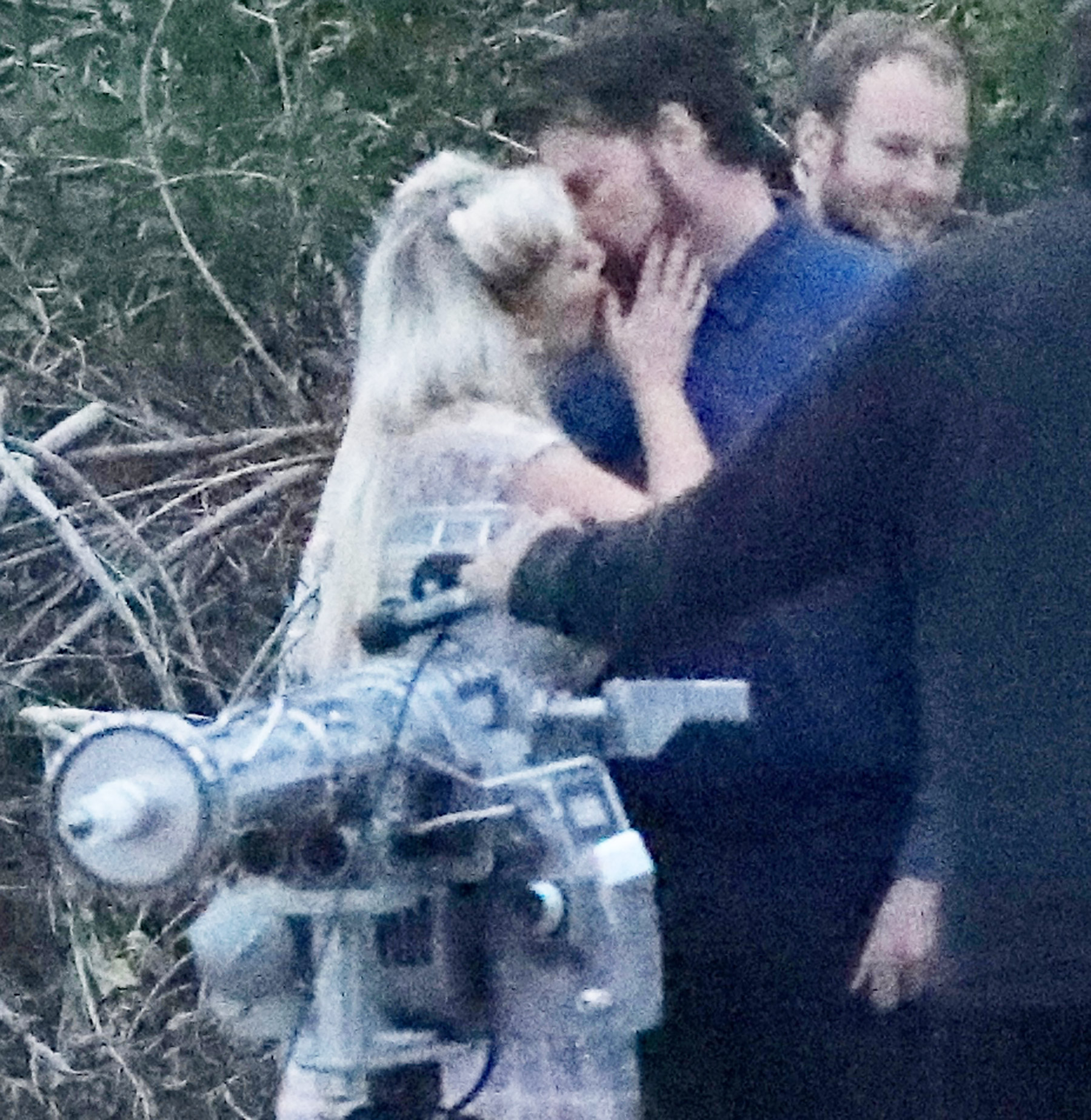 EXCLUSIVE: Tori Spelling and Dean McDermott kiss on a movie set just days after a 911 call amid fears about Tori's health.