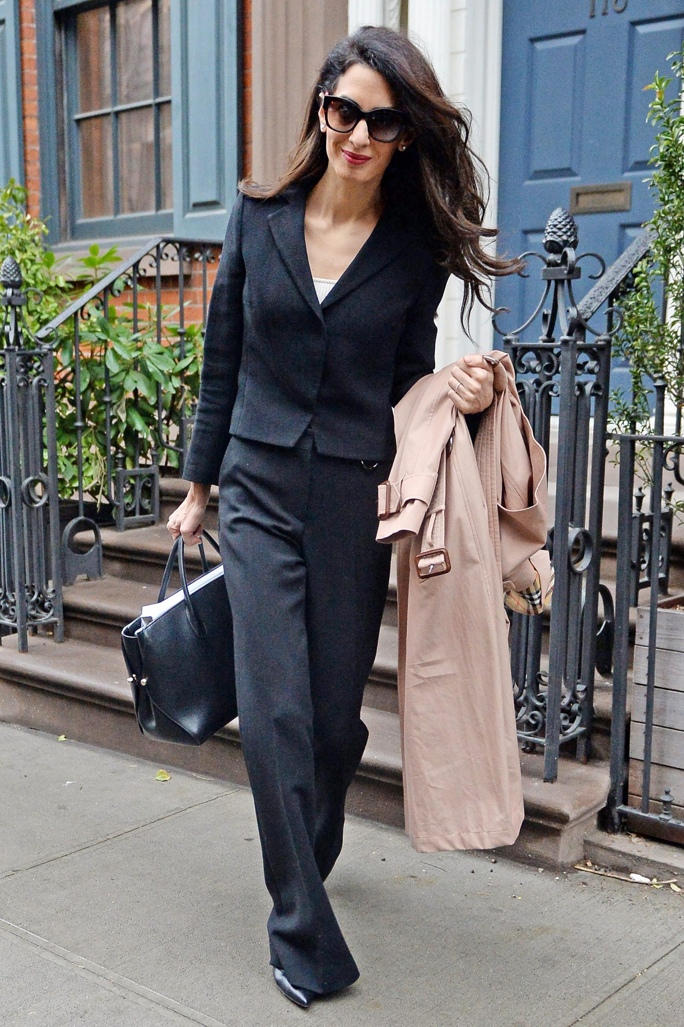 Amal Clooney photographed leaving her New York city apartment this morning on her way to Columbia University