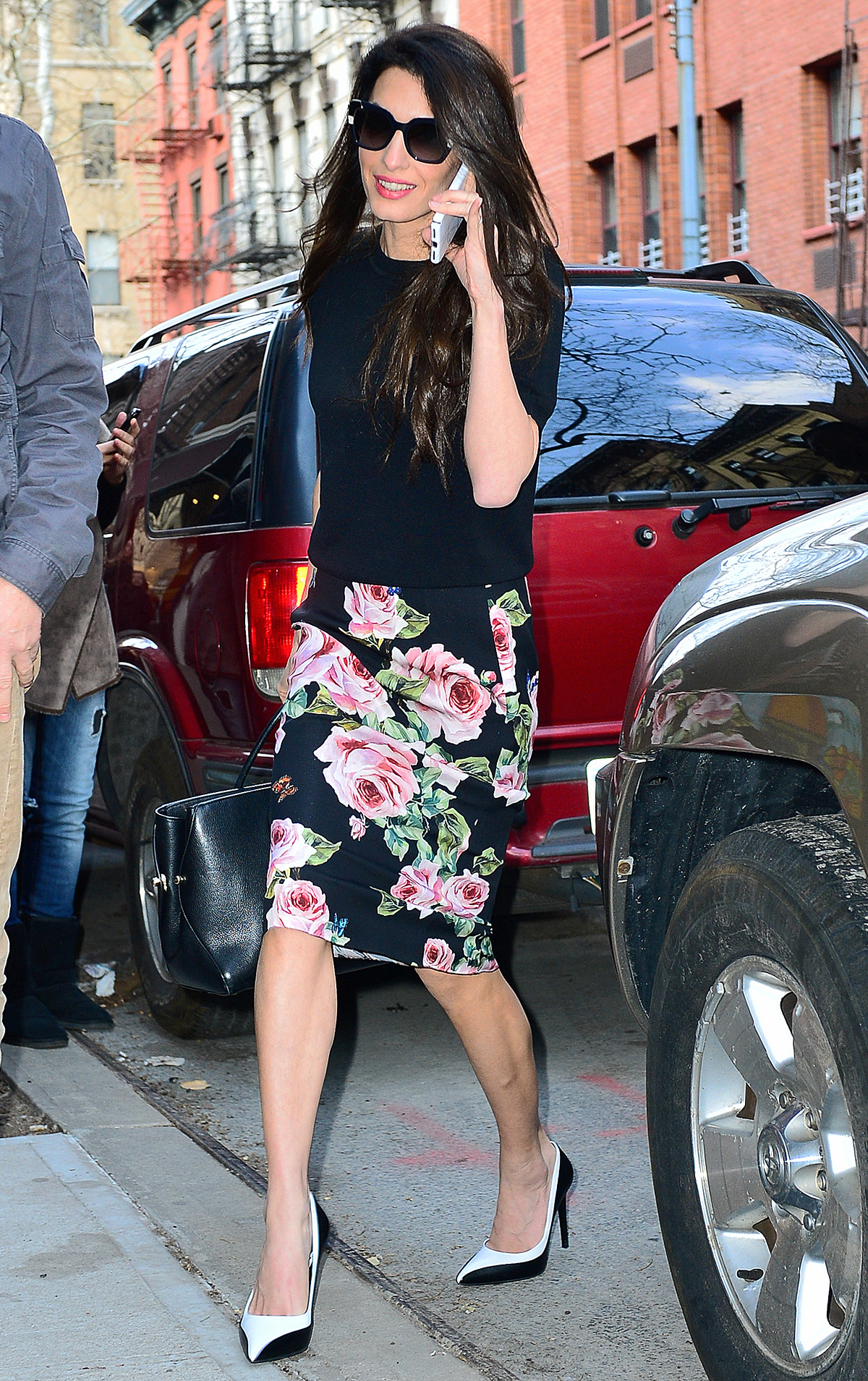 Amal Clooney is all smiles as she steps out wearing a floral skirt after teaching at Columbia University in NYC