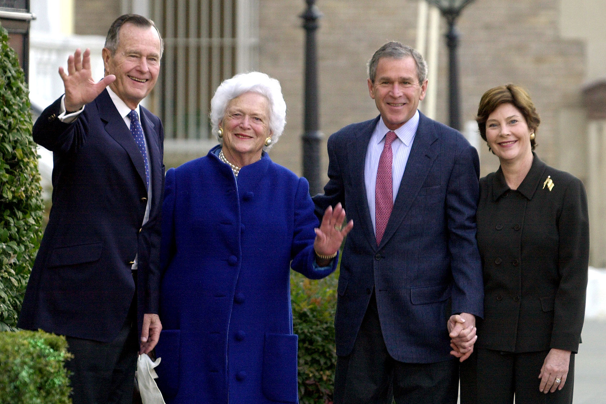 President Bush, second right, and first lady Laura Bush, right, leave Saint John's Church in Washington, Sunday, Jan 27, 2002, with former President George H. W. Bush and former first lady Barbara Bush after attending Sunday service. President Bush will deliver his first State of the Union address on Tuesday. (AP Photo/Susan Walsh)