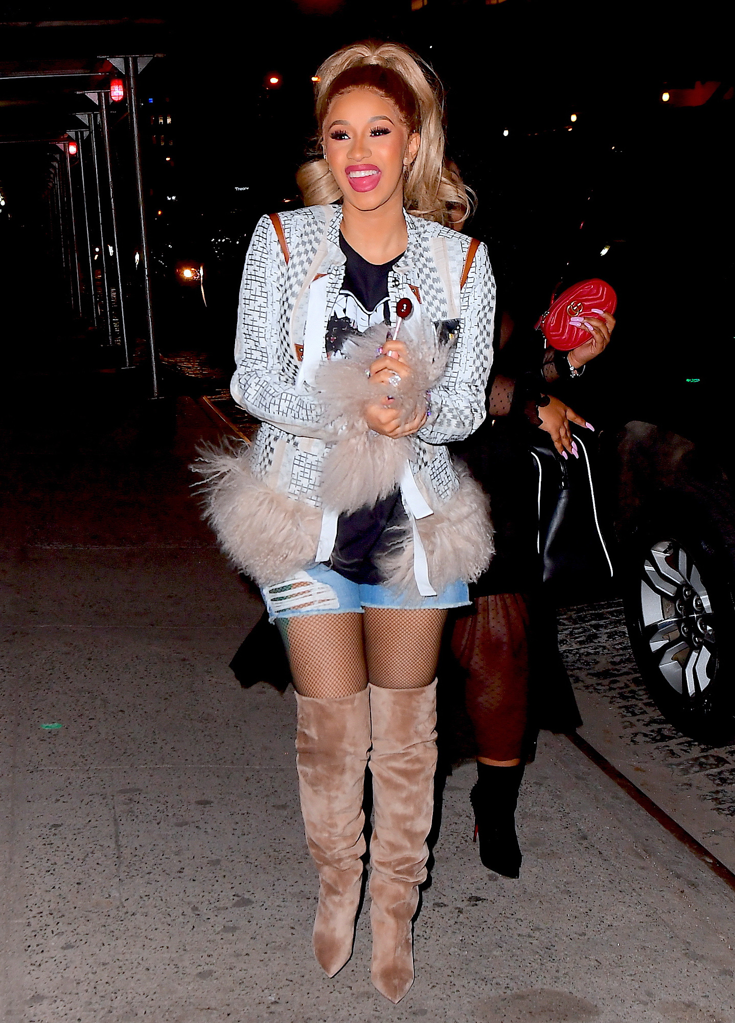 Cardi B Covers What Appears to Be a Baby Bump as She Celebrates Her Album Release in NYC