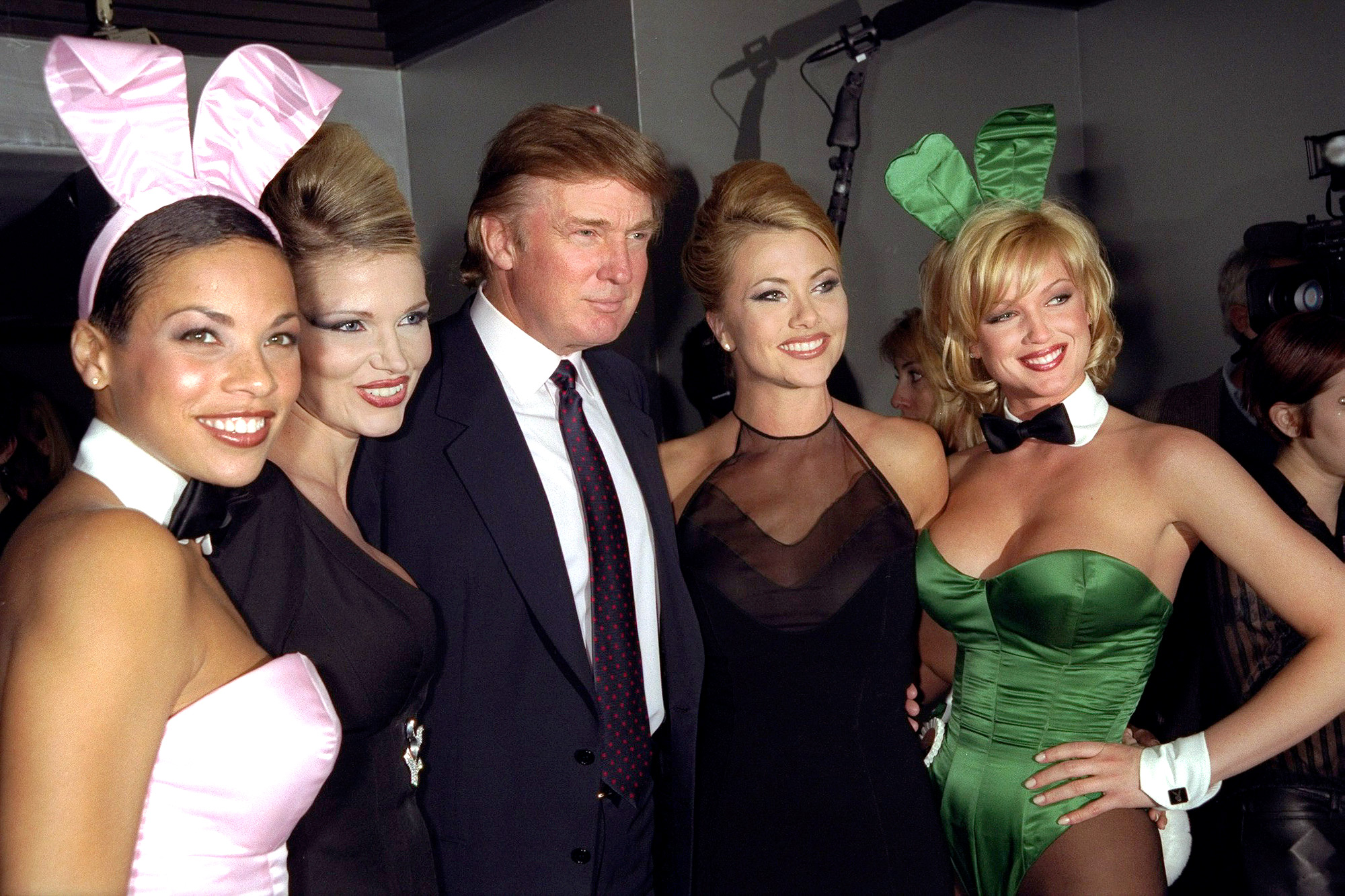 Donald Trump is flanked by Playmates at a party celebrating