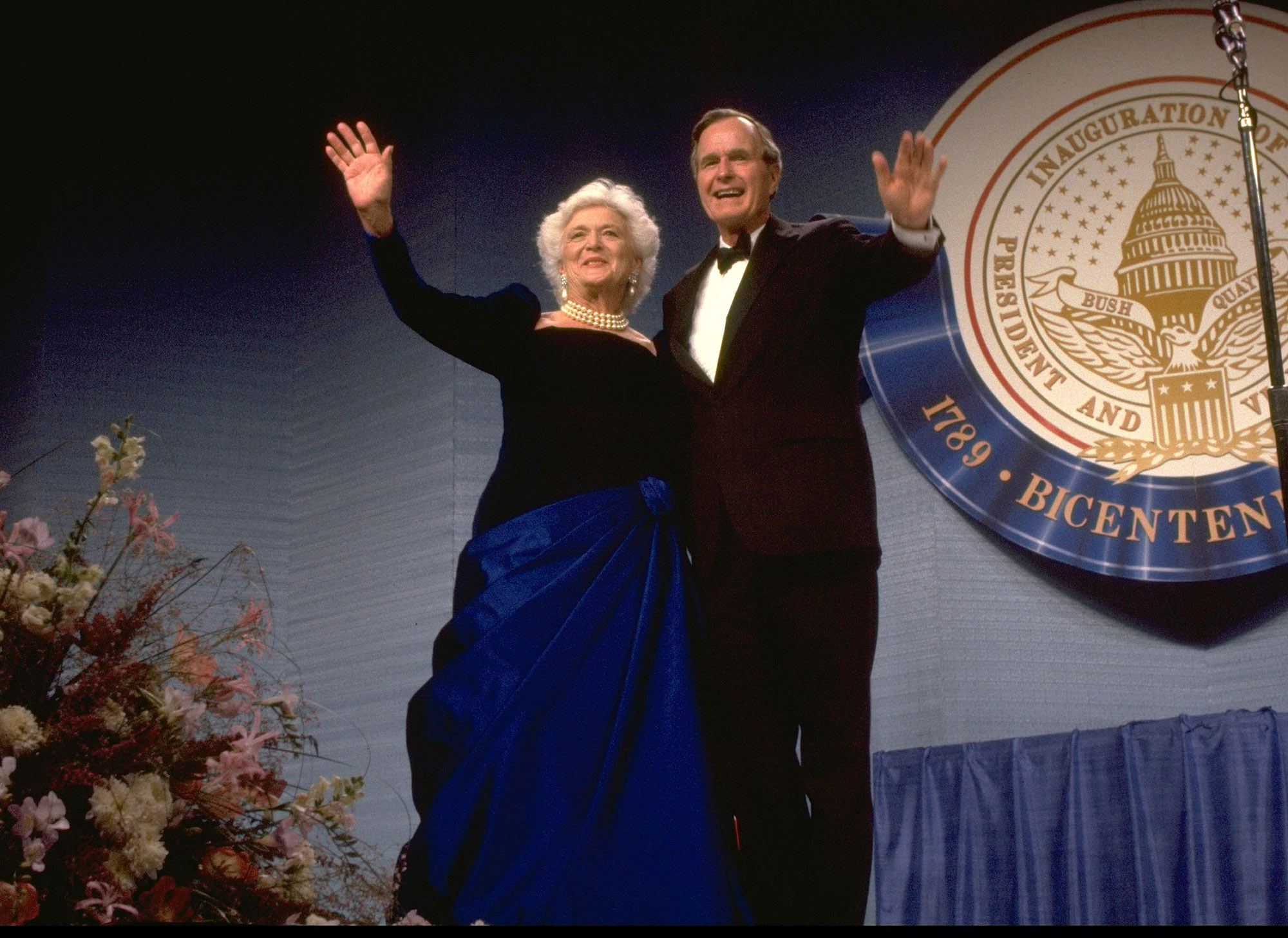 Pres. George & Barbara Bush onstage at inaugural ball greeting wellwishers. (Photo by Diana Walker//Time Life Pictures/Getty Images)