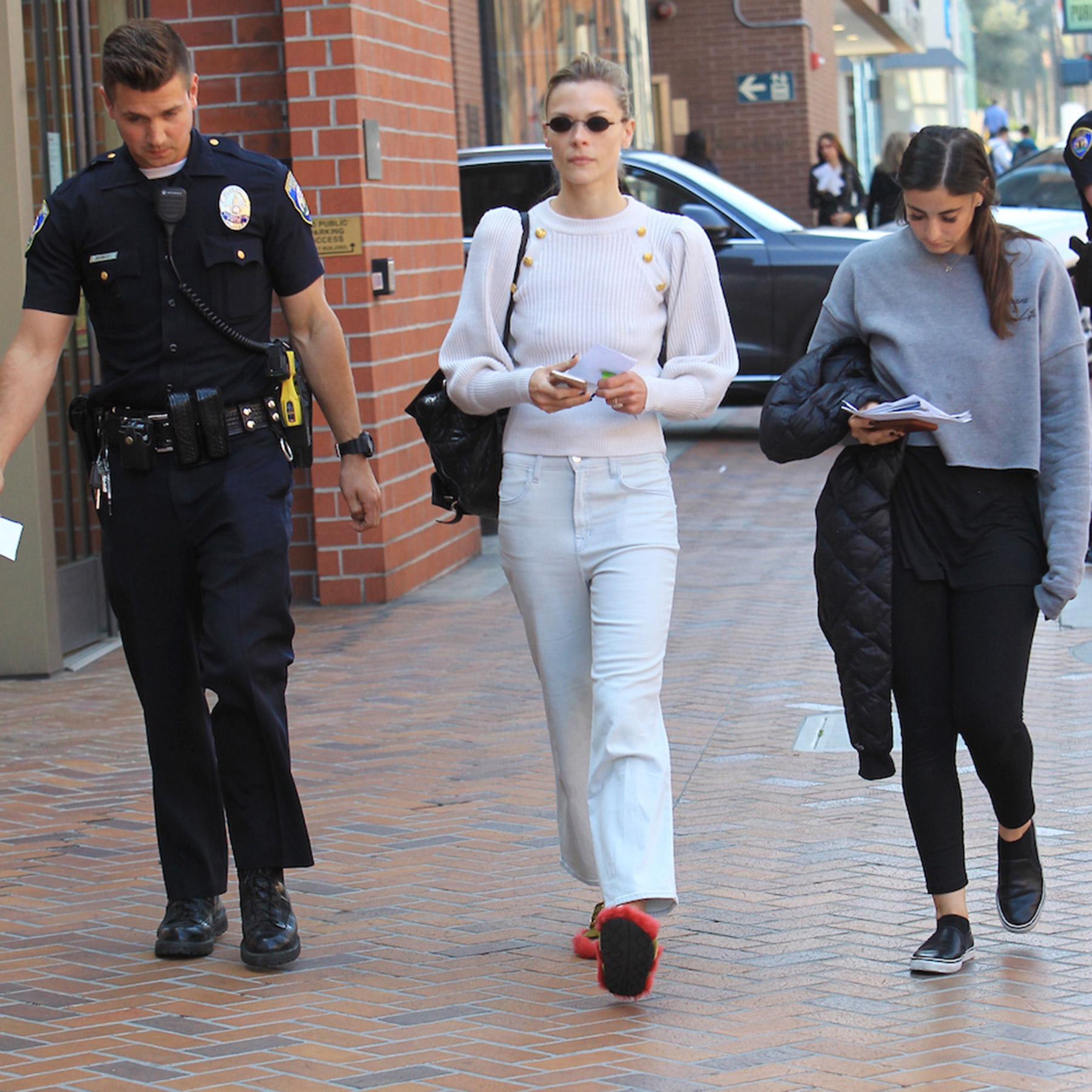 Jaime King gets into an incident with a crazy man who jumped onto her car in Beverly Hills