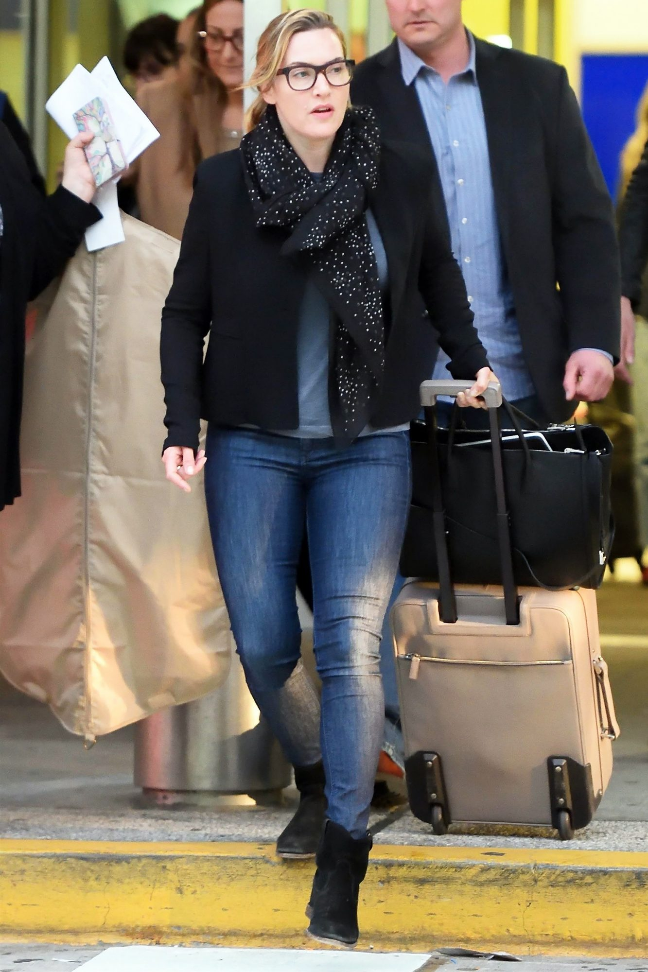 Kate Winslet arrives on a flight at JFK airport