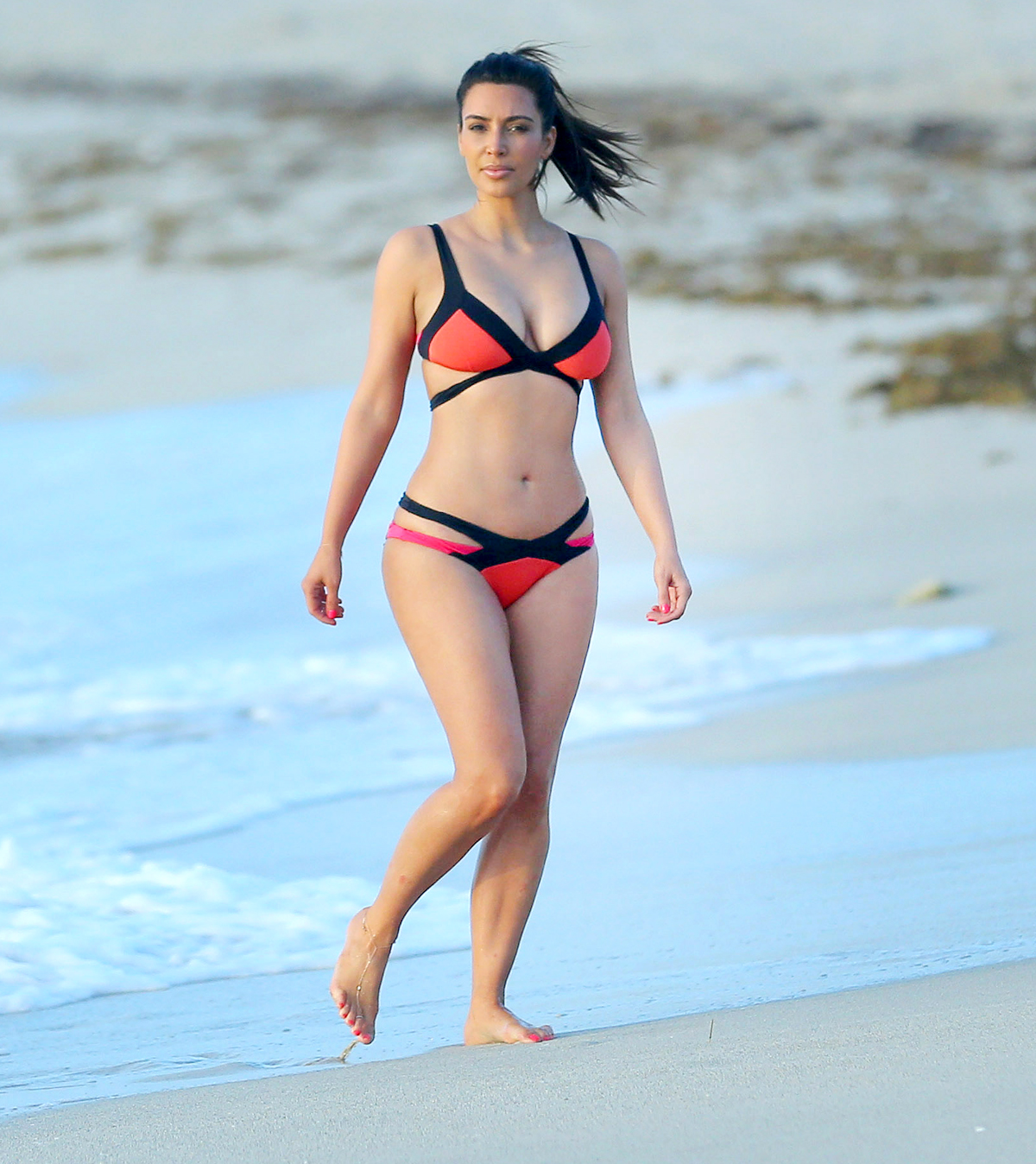 EXCLUSIVE: Kim Kardashian wears a colorful bikini on Miami beach with Jonathan Cheban! Photos taken on July 21st, 2012