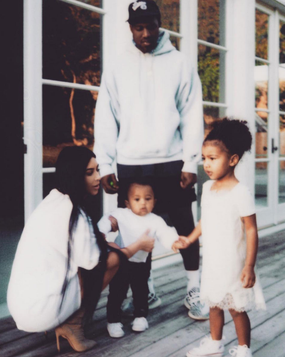 KANYE VISITS HIS MOTHER'S GRAVE WITH KIM & THEIR KIDS