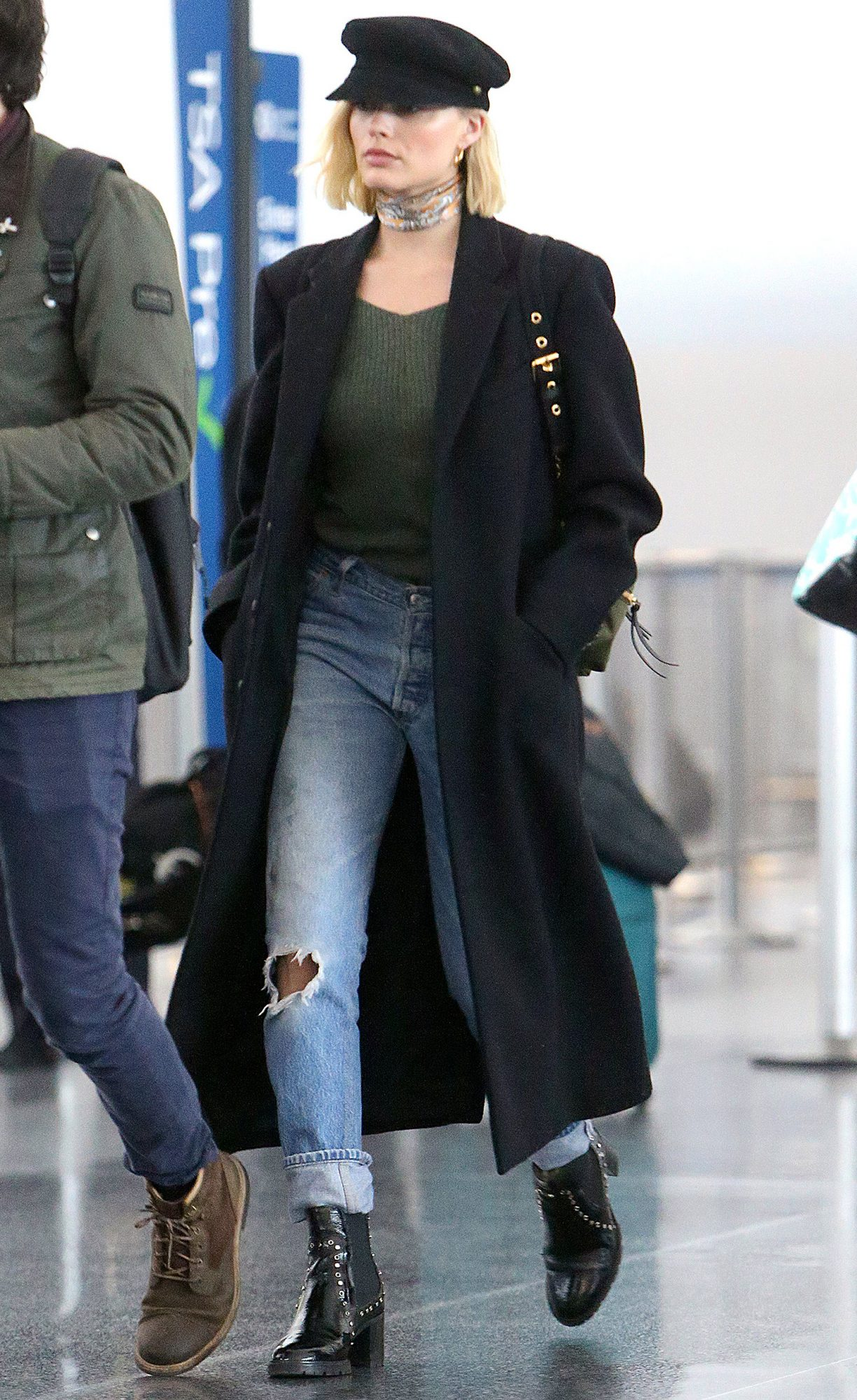 Margot Robbie departs out of JFK airport with a Mystery Man after a low key trip in New York City.