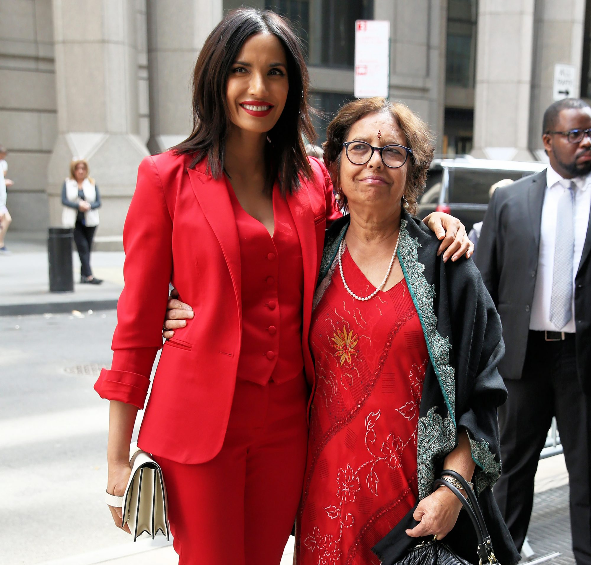 Top Chef TV personality Padma Lakshmi, wearing a red pants suit, and her mother Vijaya Lakshmi attend Variety's 'Power of Women' luncheon at Cipriani Wall Street in New York City, New York on April 13, 2018.
