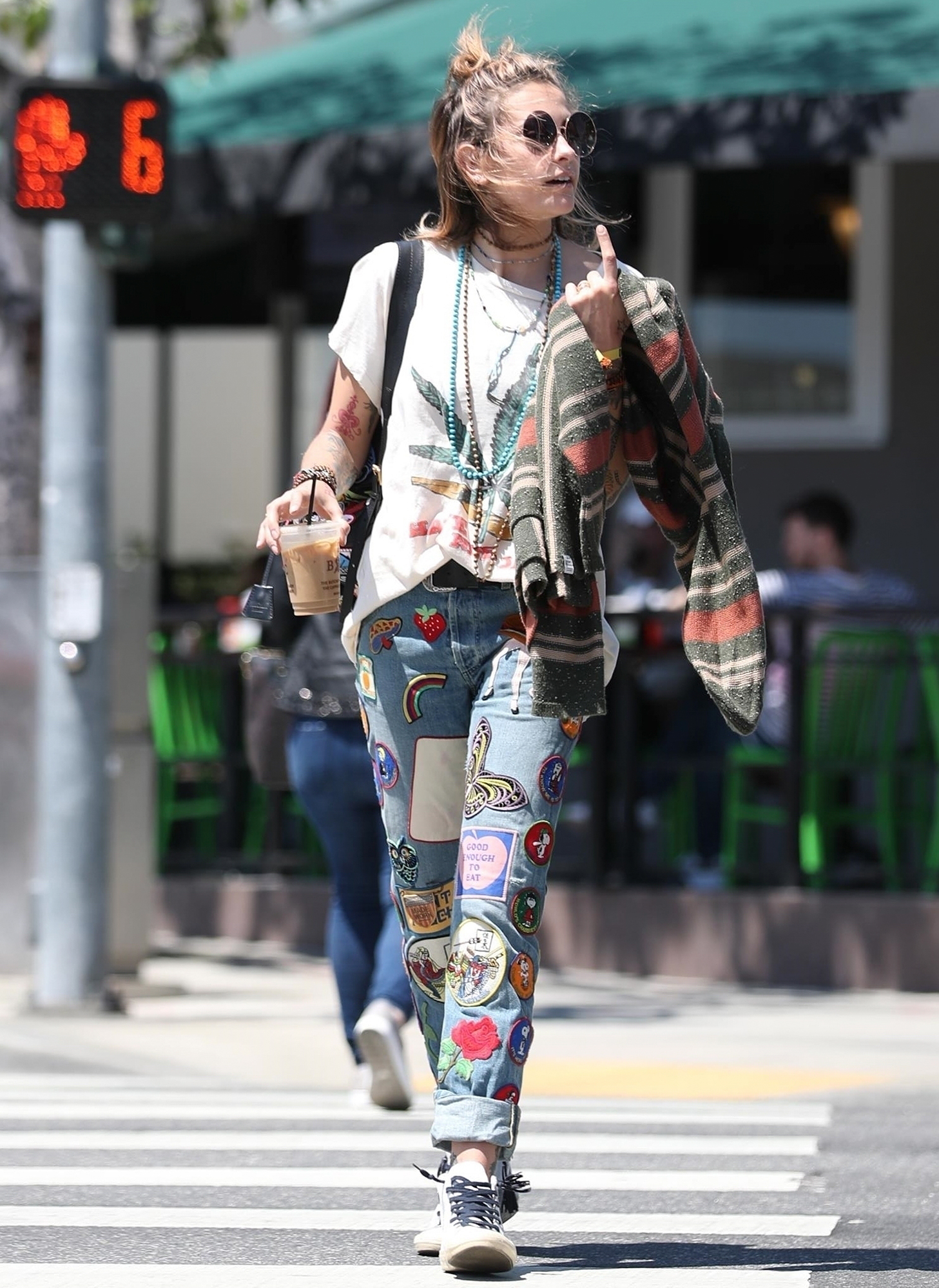 Paris Jackson grabs lunch with a friend while proudly showing off a marijuana shirt