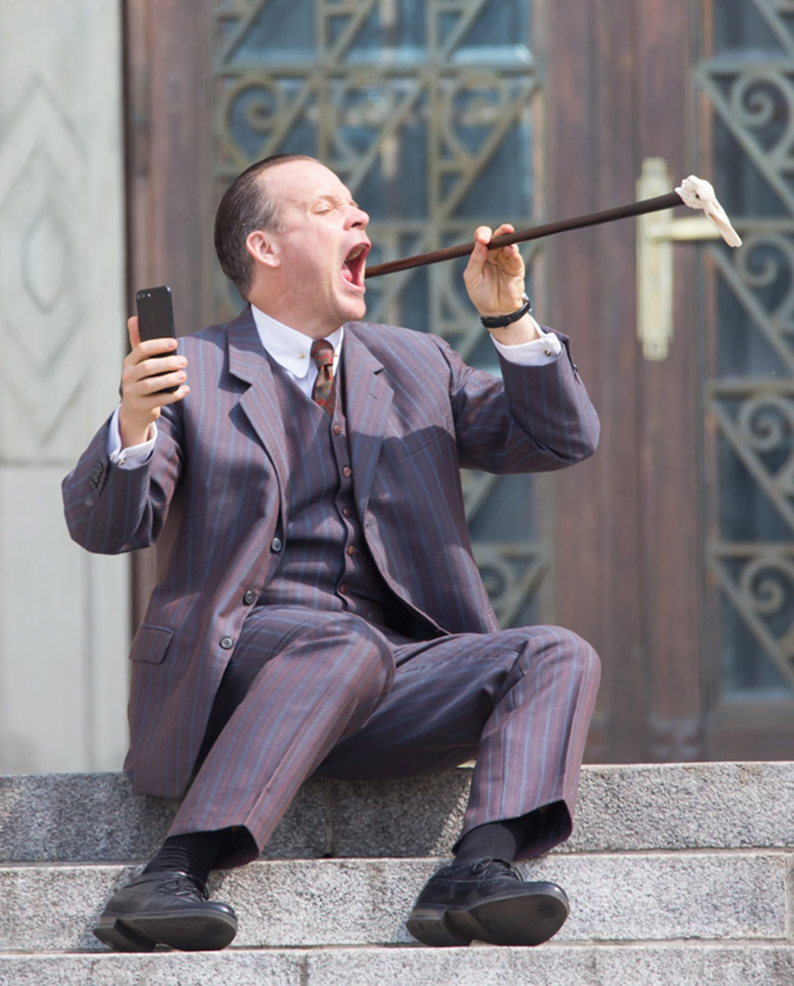 EXCLUSIVE: Peter Sarsgaard fools around with a cane on set