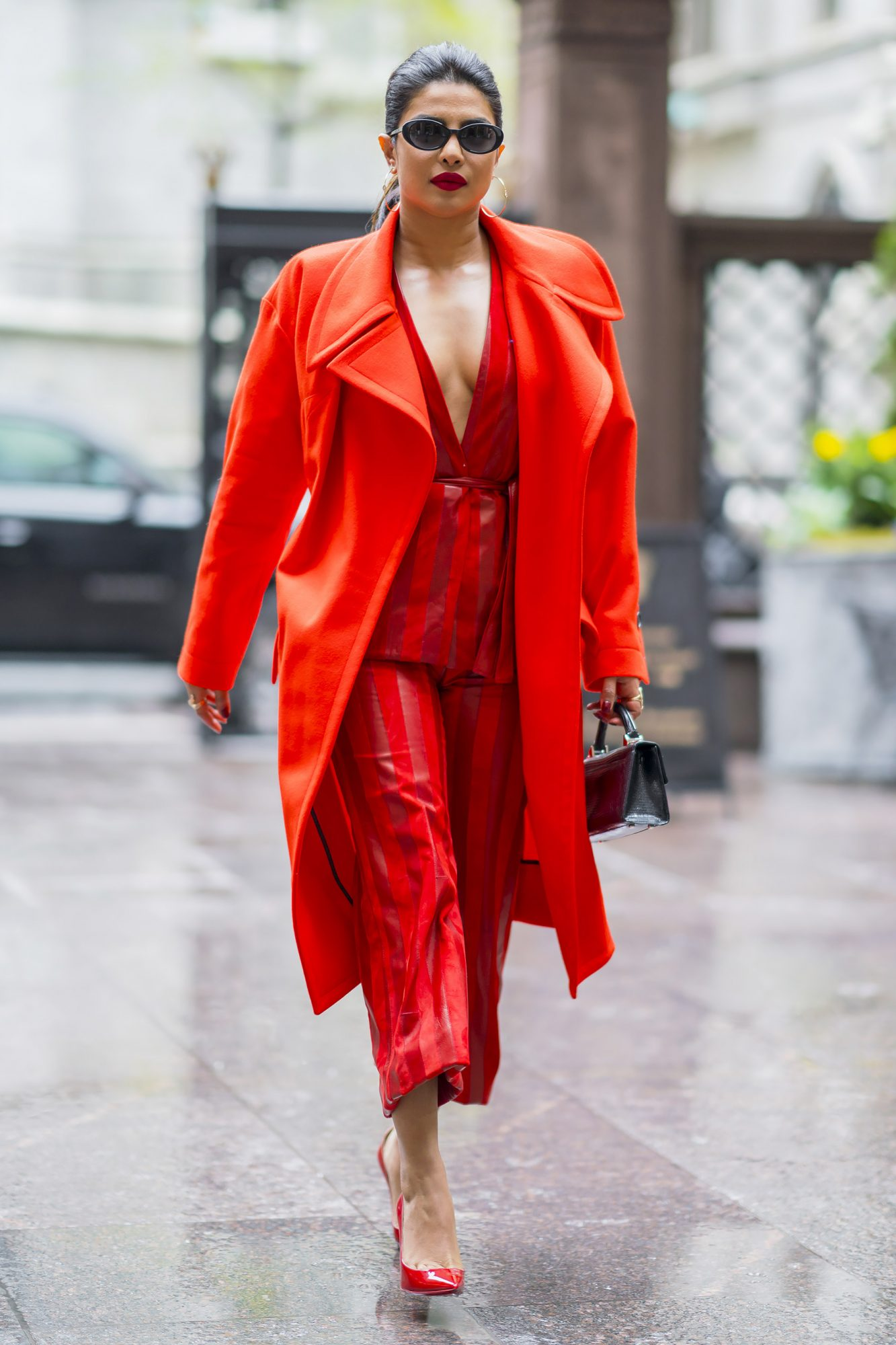 Priyanka Chopra is seen wearing all red Alejandro Alonso Rojas top and pants with a Vivienne Westwood jacket and Christian Louboutin shoes in Midtown