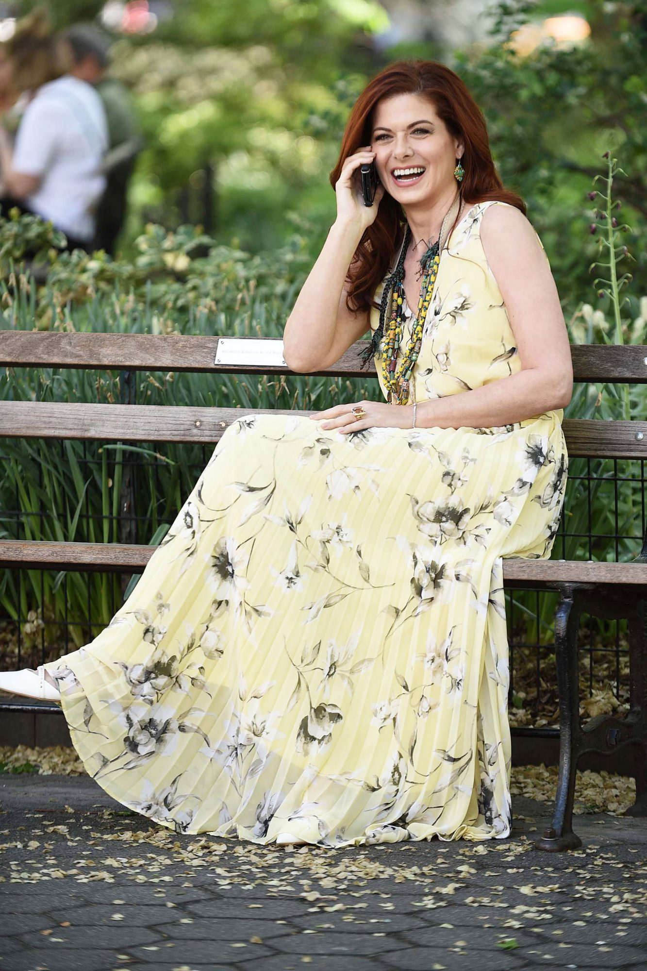 Debra Messing on her Phone in the Park