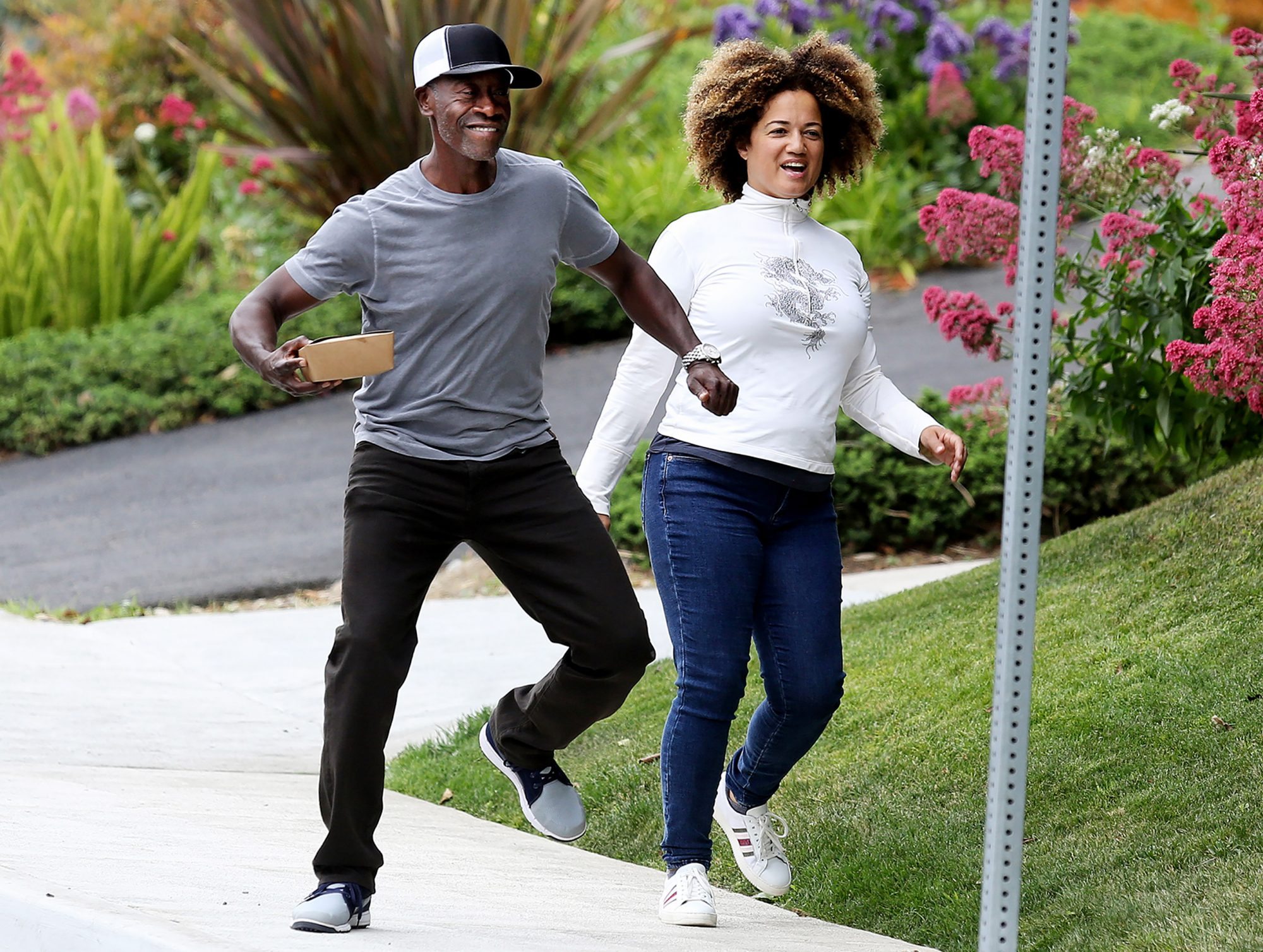 EXCLUSIVE: Don Cheadle gets silly with wife while walking off breakfast in LA.