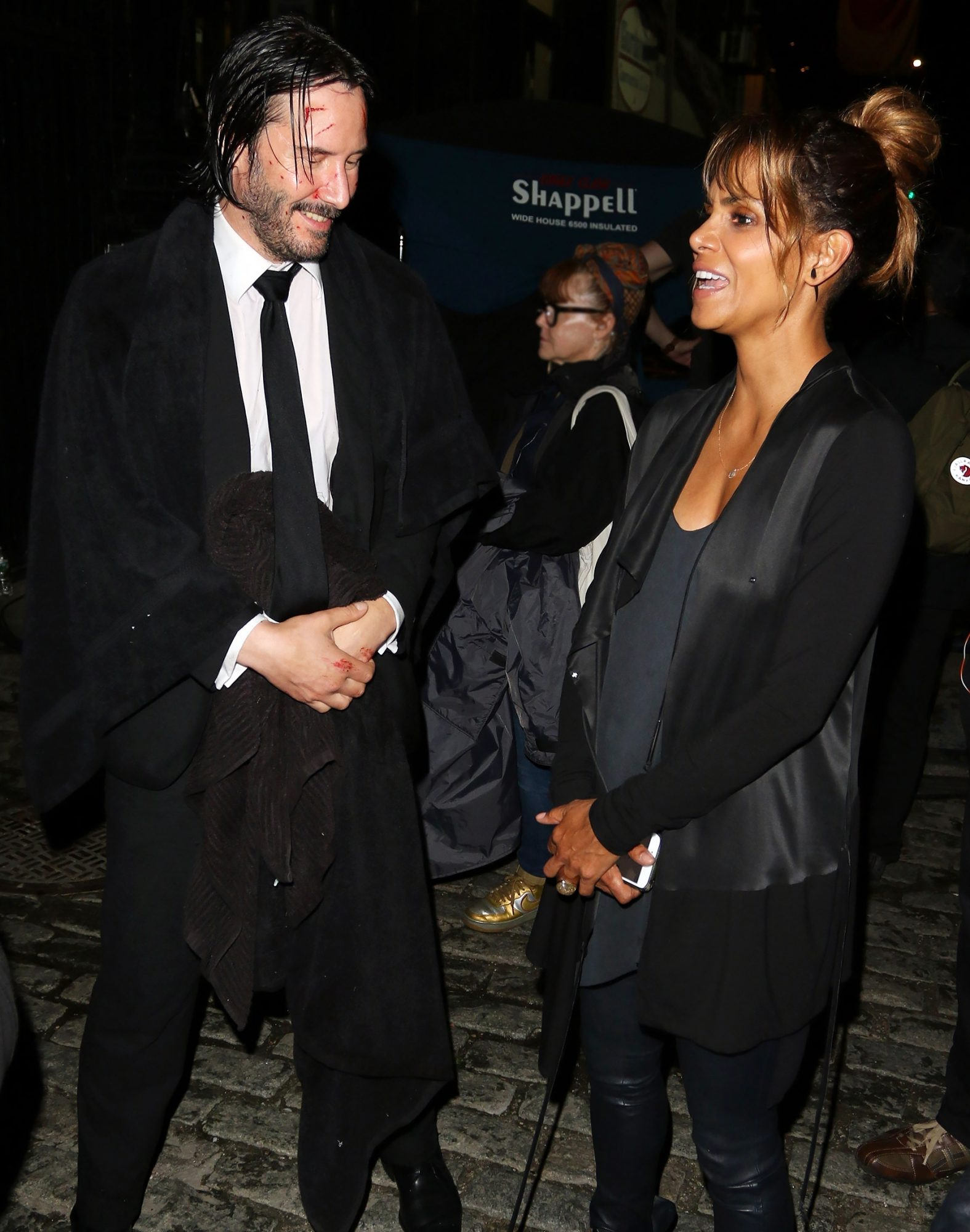 Halle Berry chats with Keanu Reeves on set of 'John Wick 3' during a late night of filming