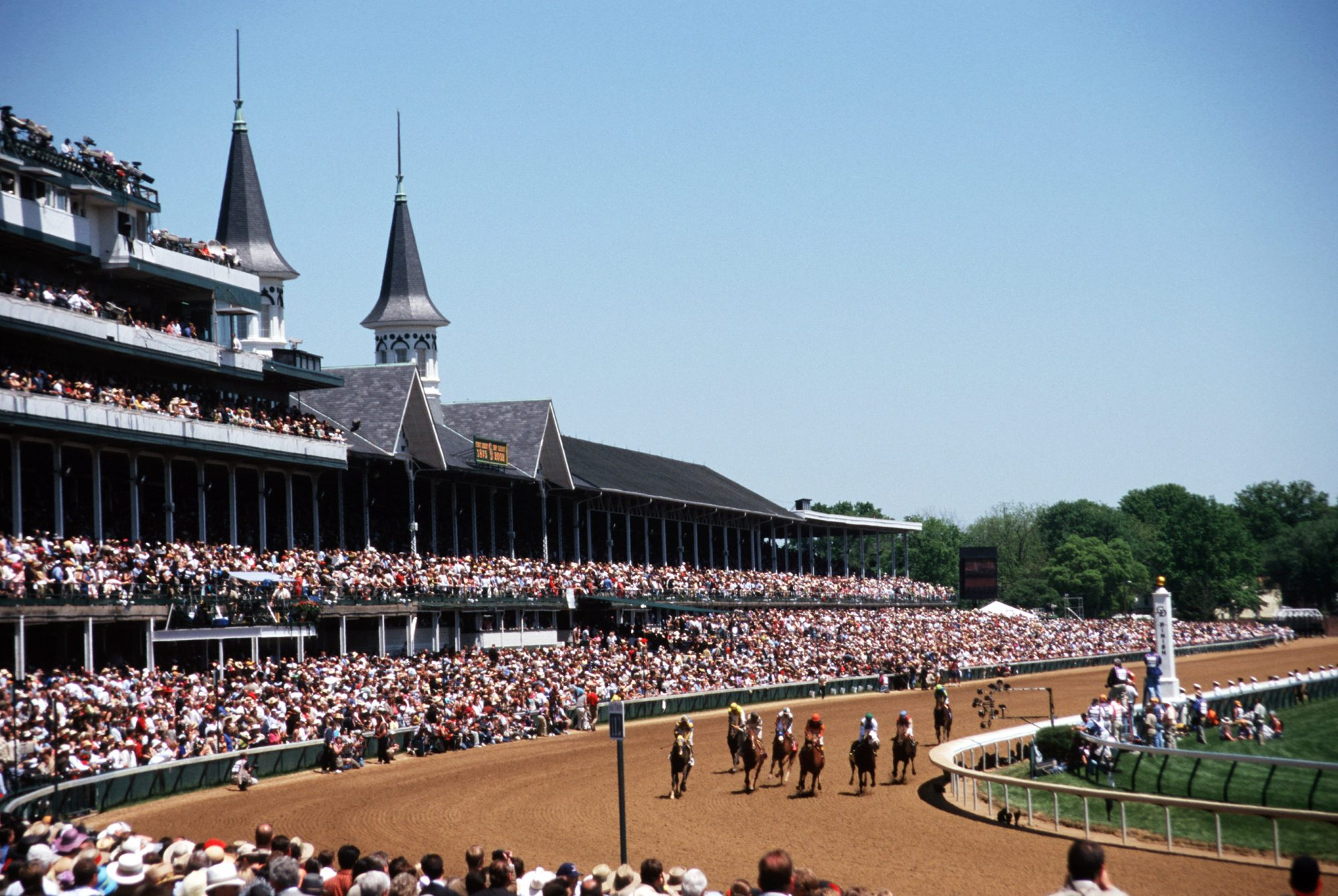 Kentucky, Louisville, Churchill Downs, Kentucky Derby, Run For The Roses, Grandstand And Horses Racing On Track.