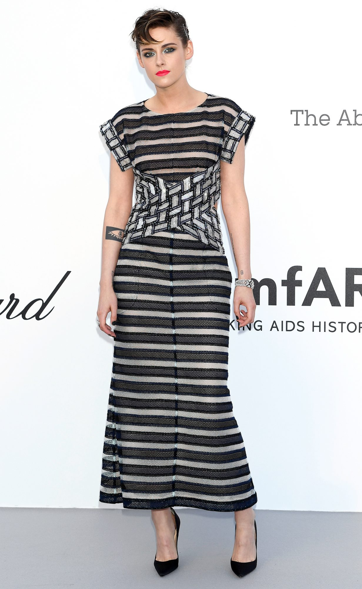 KRISTEN STEWART The juror wore a semi-sheer embroidered striped dress from Chanel with black pumps and a bright orange lipstick to amfAR's 25th Cinema Against AIDS Gala.