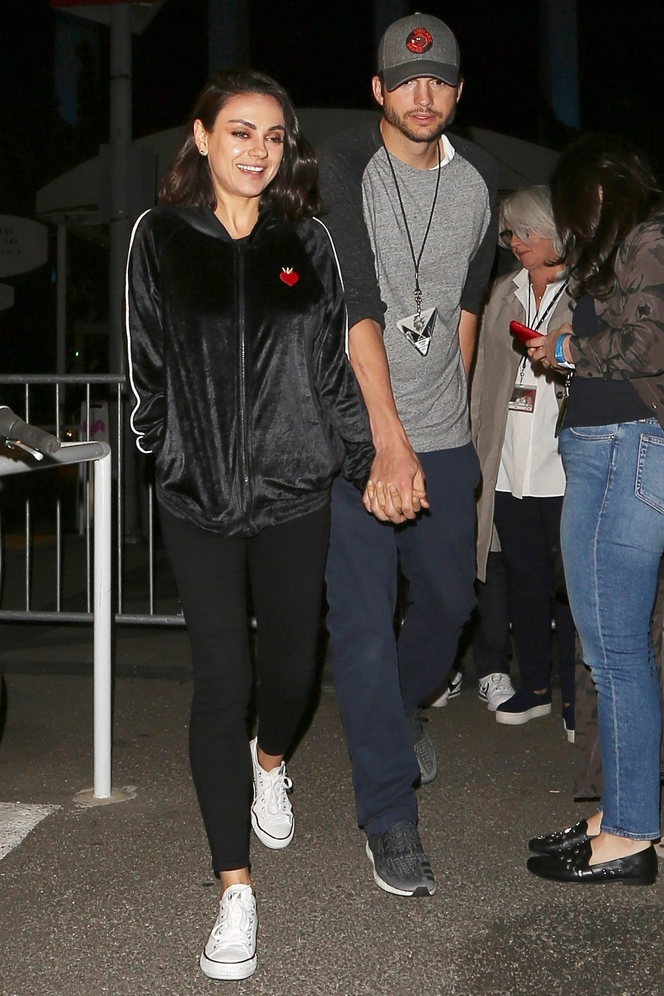 Mila Kunis and Ashton Kutcher have date night at the U2 Concert