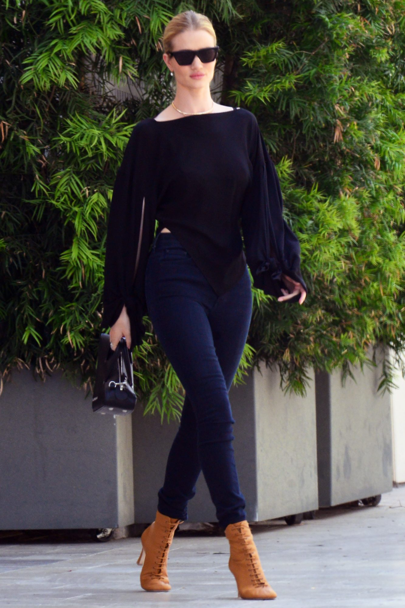 EXCLUSIVE: Rosie Huntington-Whiteley shows off her designer bag as she heads to a meeting in Beverly Hills, Ca
