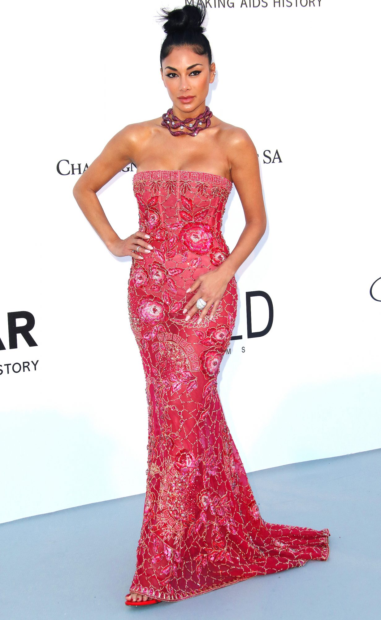 NICOLE SCHERZINGER The singer raspberry red tulle gown embroidered with sequins, crystals and beads designed by Georges Hobeika Couture with a matching colored choker necklace to amfAR's 25th Cinema Against AIDS Gala.