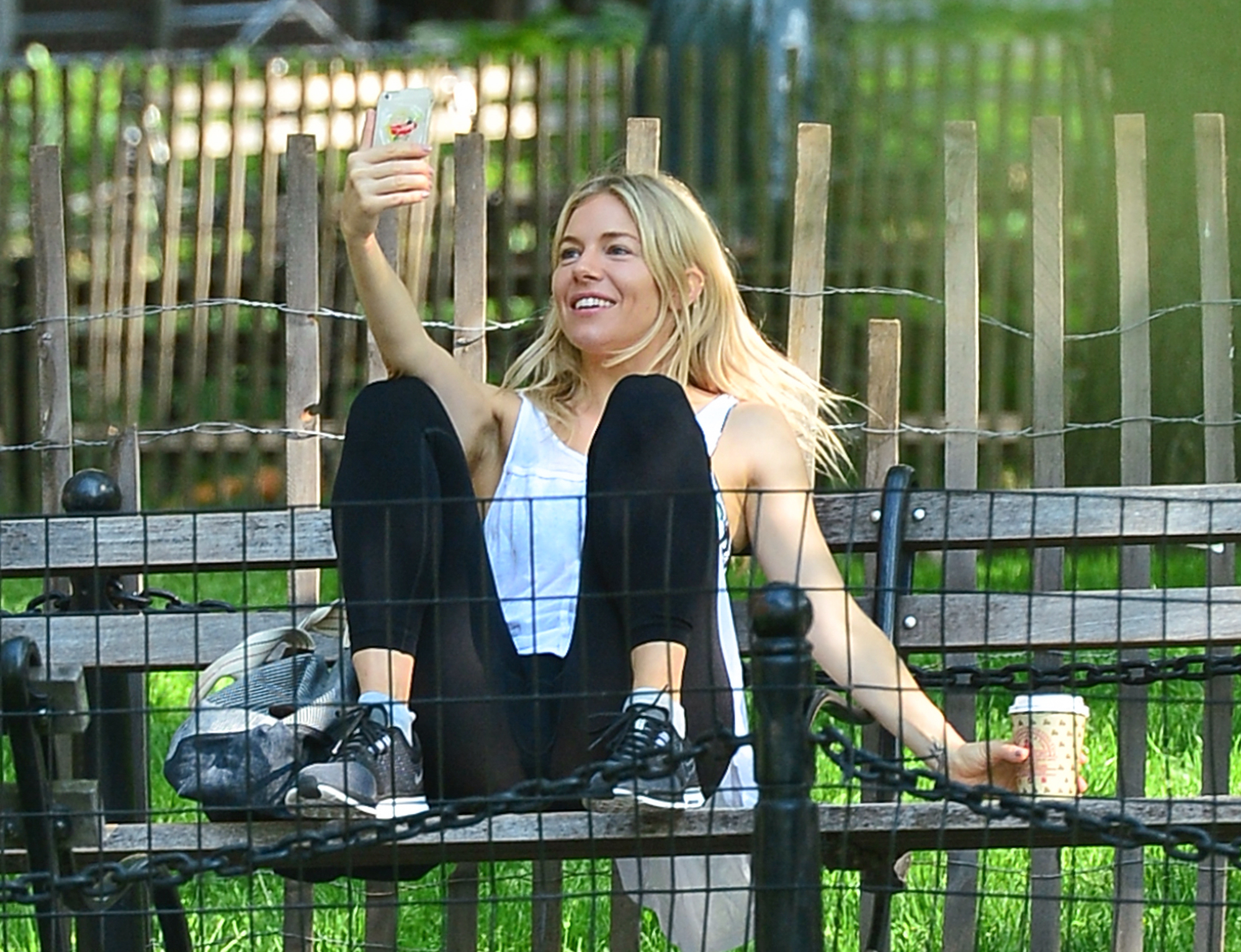 EXCLUSIVE: Sienna Miller takes selfies in Washington Square Park as she enjoys the sunny day in NYC