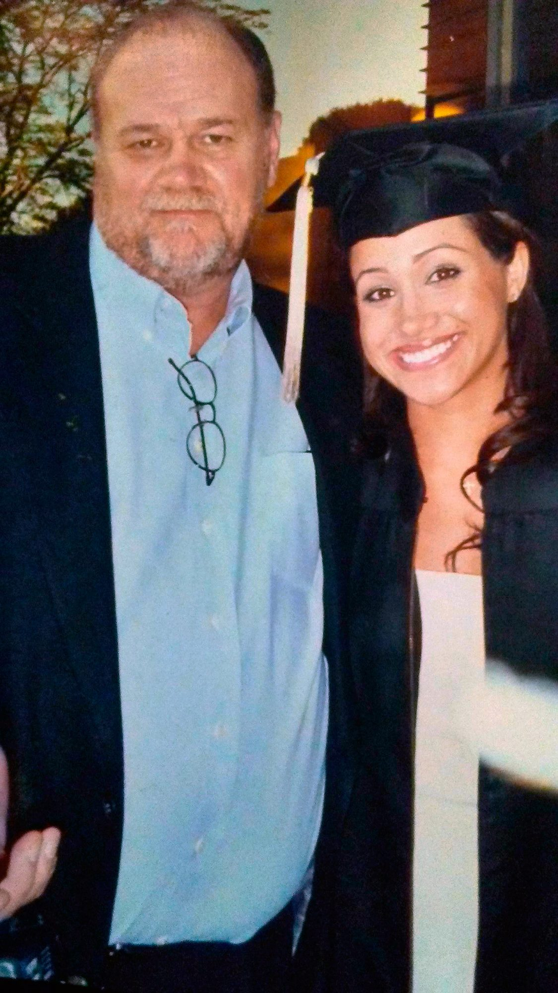 This exclusive collect photo shows a young Meghan Markle on her high school graduation day, accompanied by her father Thomas Markle Senior.
