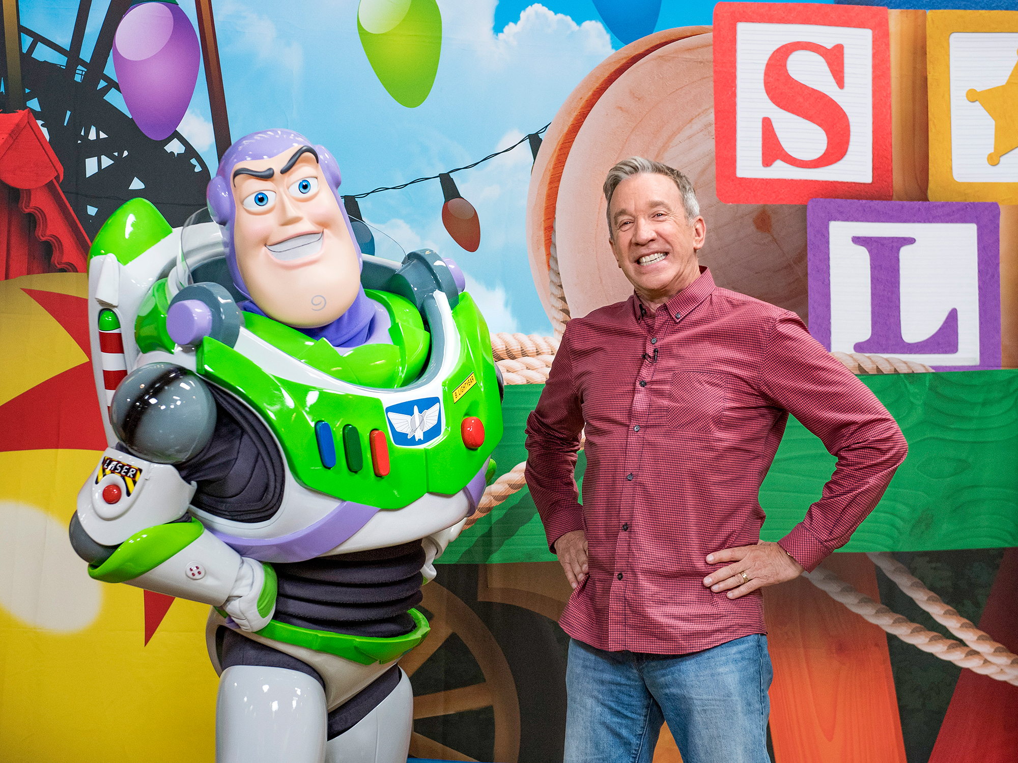 Tim Allen poses with Buzz Lightyear for Toy Story Land