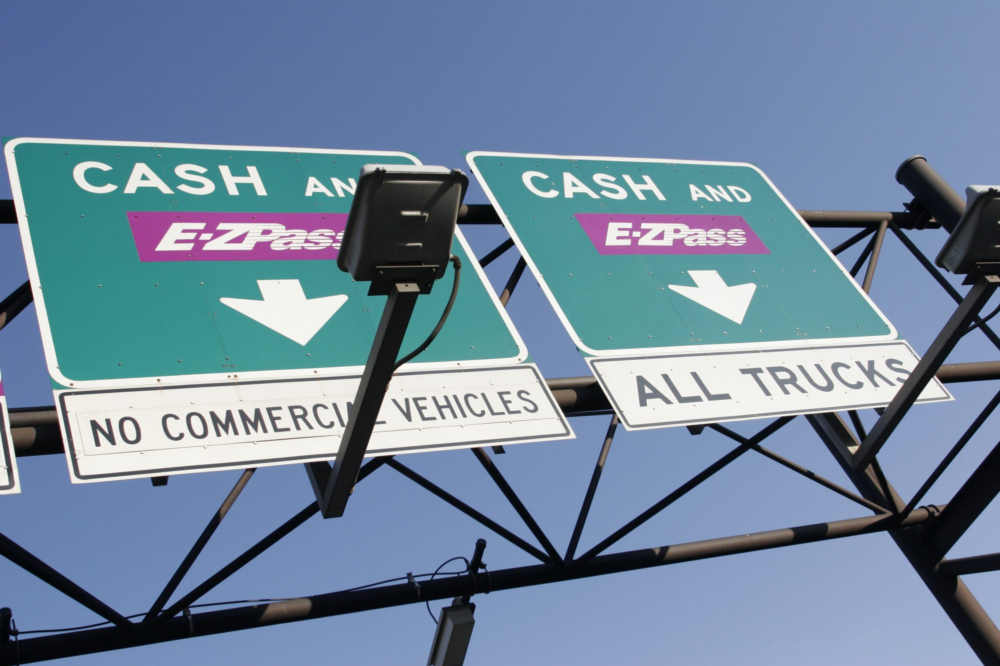 Cash and E-Z Pass signs at the New Jersey Turnpike.