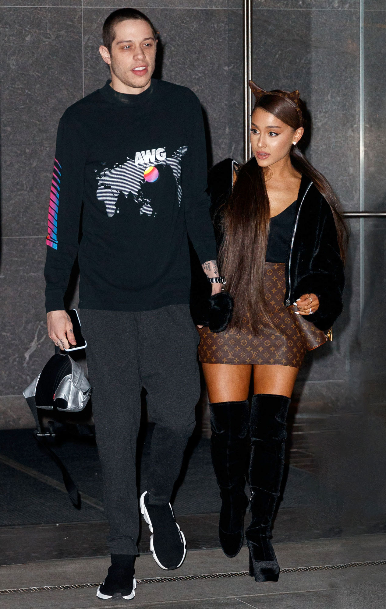 Ariana Grande wears a Louis Vuitton leather skirt when heading out for dinner with Pete Davidson in New York