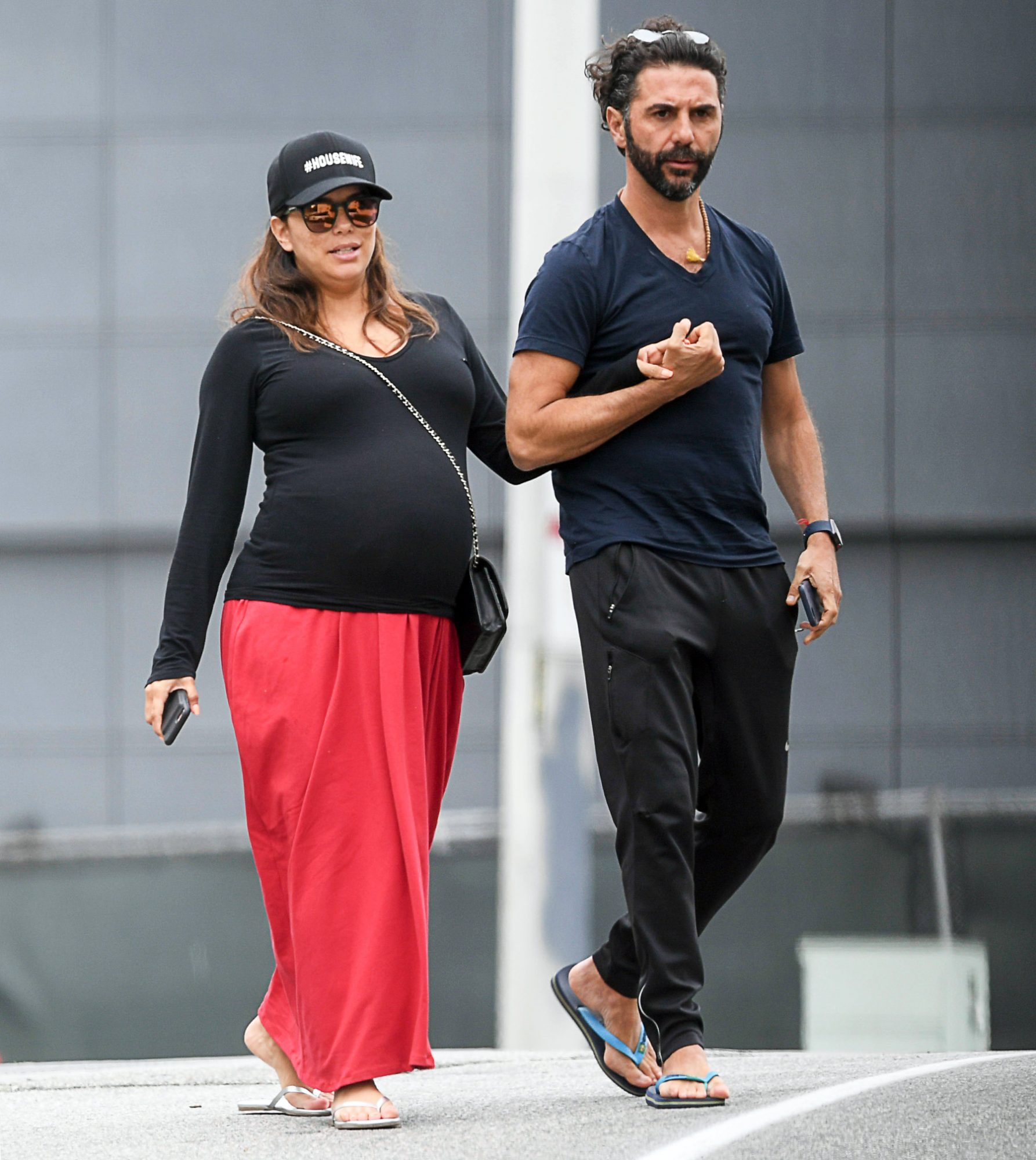 Eva Longoria and husband Jose Baston show affection as they leave a late lunch at Tocaya
