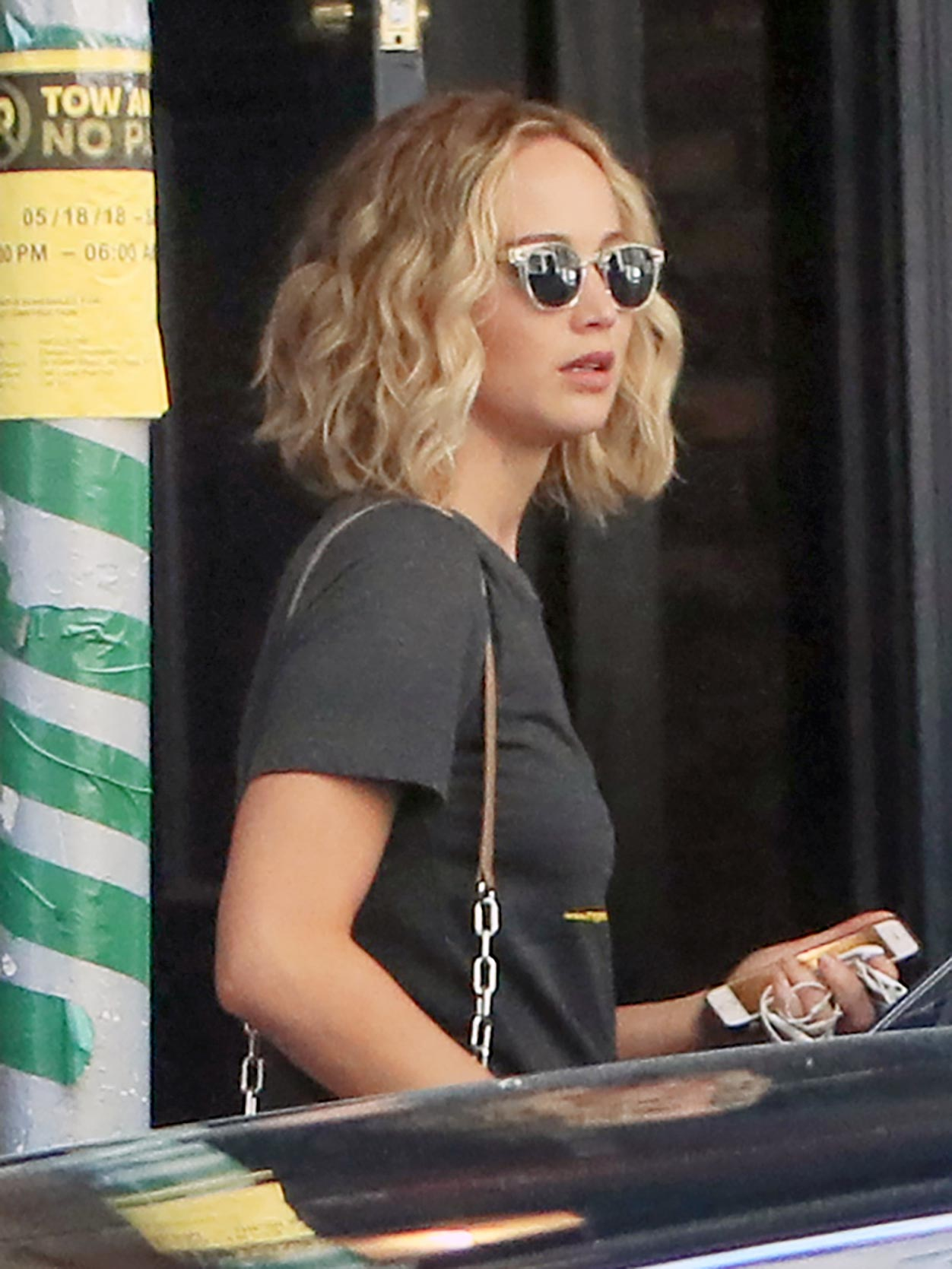 EXCLUSIVE: Jennifer Lawrence is Spotted Exiting an Apartment Building in New York City.